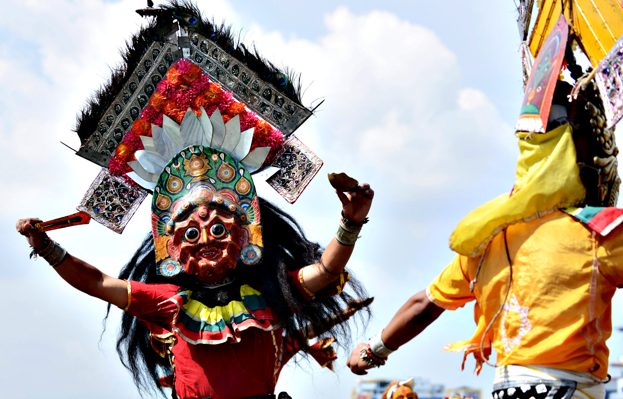 Nepalese masked dancers perform during celebrations for the 7th anniversary of Republic Day in Kathmandu on May 29, 2014. Political parties in Nepal are working to draft a new constitution following the country's Constituent Assembly elections held on November 19, 2013.