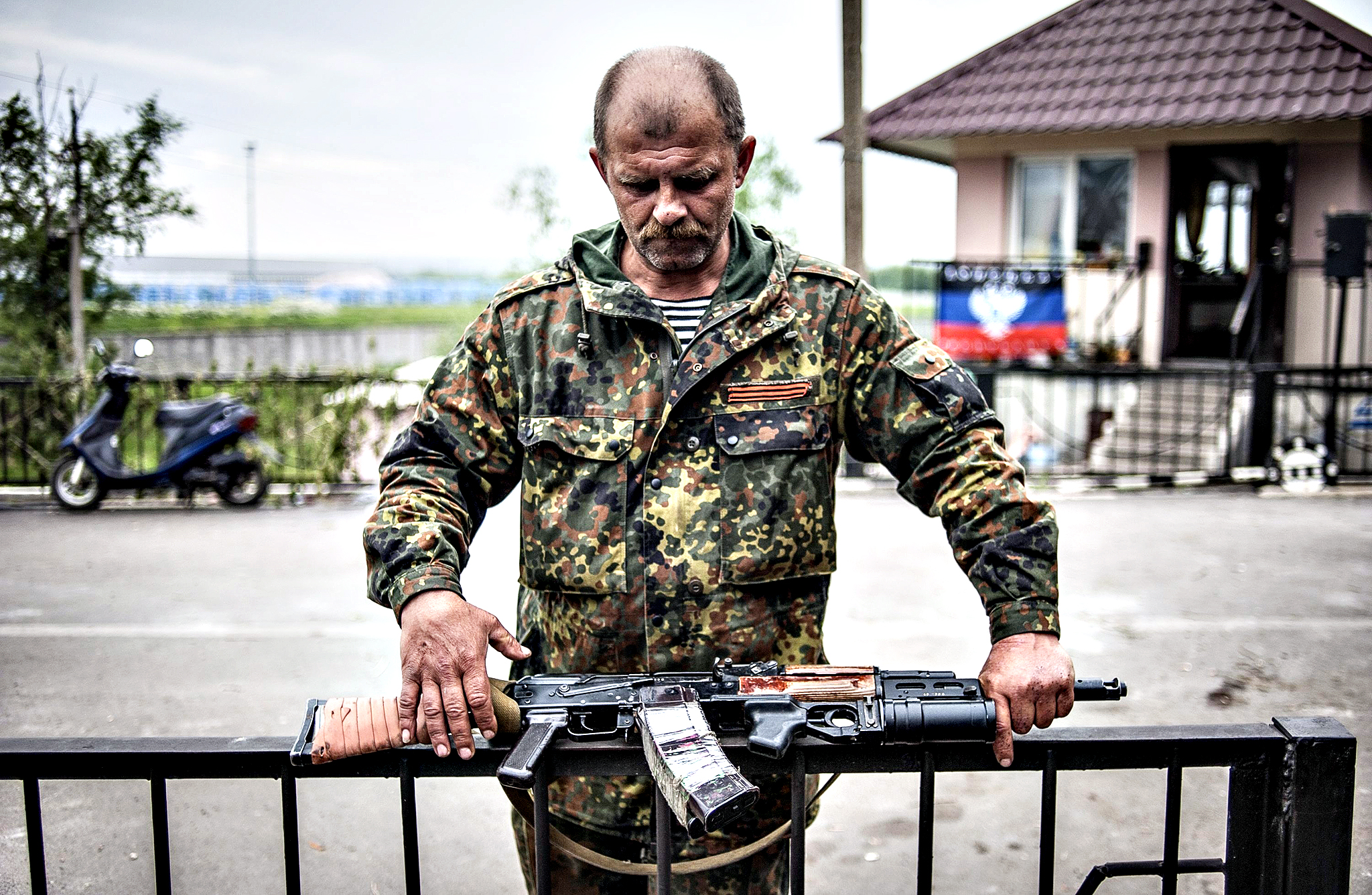 An armed pro-Russian militant stands at a checkpoint near Slavyansk, Ukraine. The secession referendum on 11 May, allowed the three million residents of the provinces of Luhansk and Donetsk vote on whether they want to remain part of Ukraine. Russian-speakers and supporters of Moscow have been rallying in the region since March, when a referendum on independence led to Russia's annexation of Crimea.