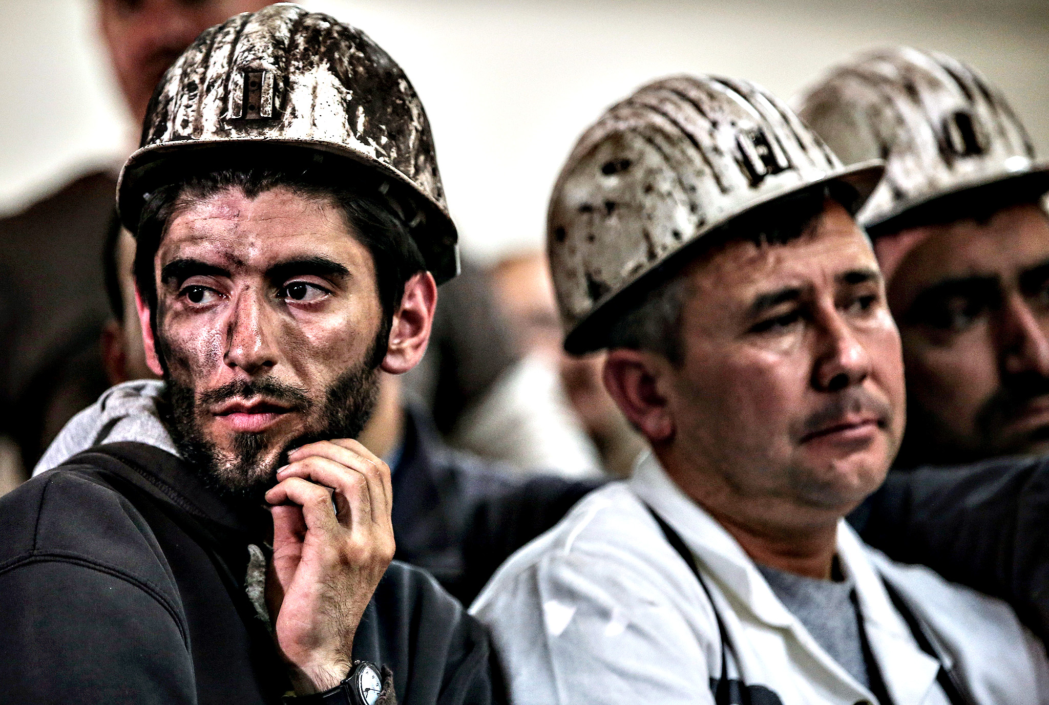 Turkish miners listen to the mining company s owner, Alp Gurkan, during a news conference in Soma, Turkey, Friday, May 16, 2014. The Turkish mining company defended its safety record Friday, four days after over 250 people died in an underground blaze at its coal mine in western Turkey.