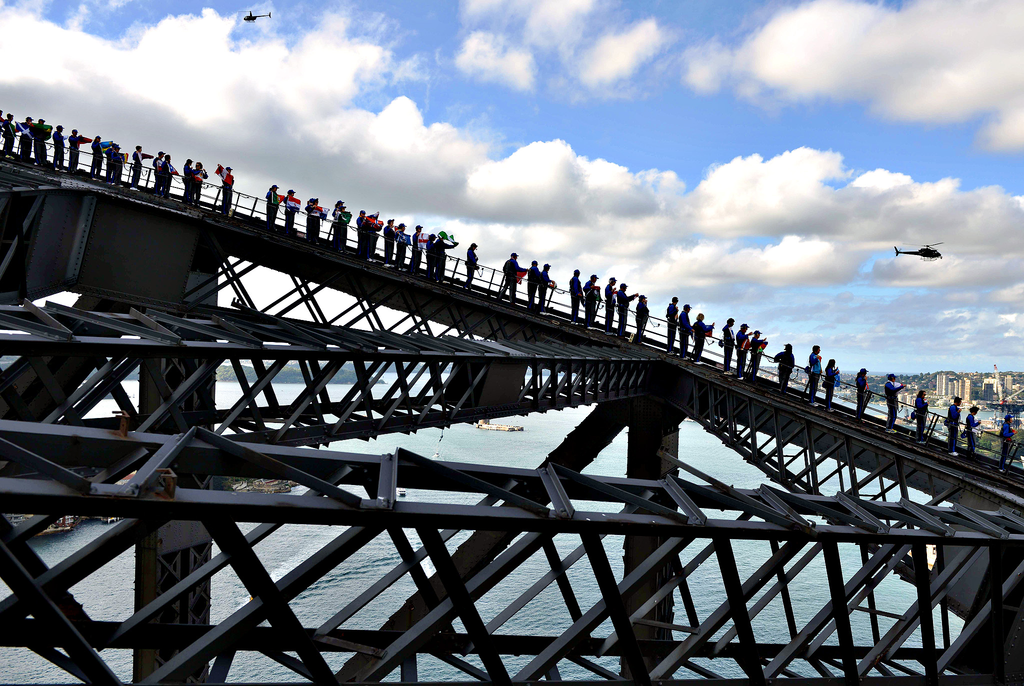 Rotary members and friends climb Sydney Harbour Bridge in an attempt to break the World Record for the most people on the bridge at one time and also the most flags on the bridge at one time in Sydney on Friday. Rotary broke the Guinness World Record for the number of people on the bridge with 340 beating the previous record of 316 organised by Oprah Winfrey in 2008. Also the record was broken for the number of different international flags flown with 219 flown beating the previous record of 143 to raise funds for Rotary's End Polio Now Campaign.