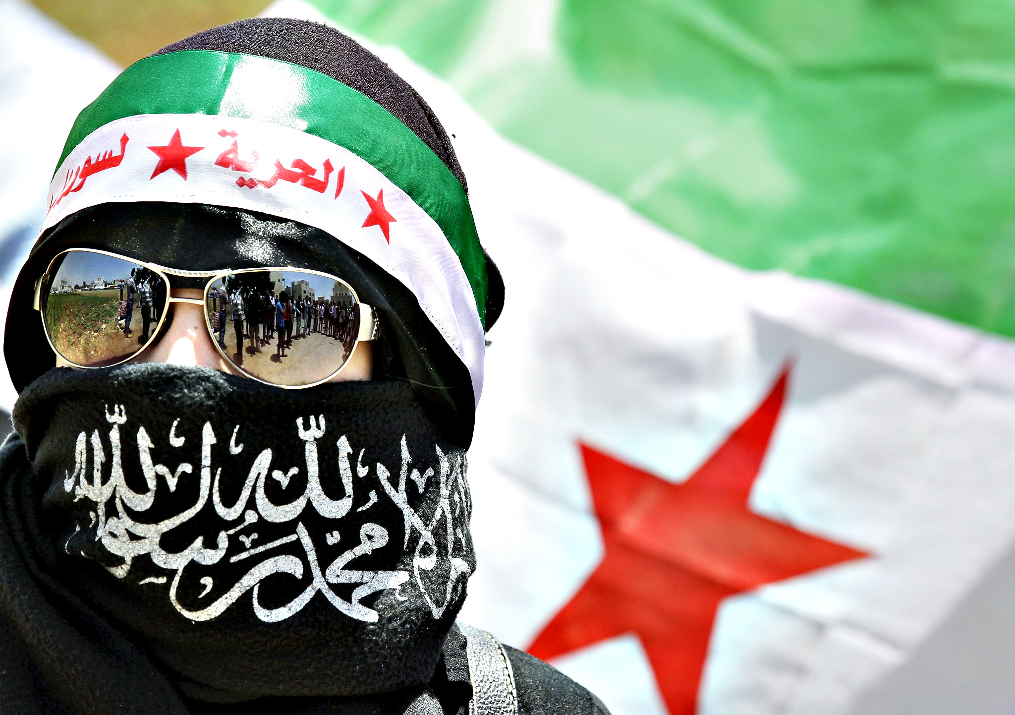 A Syrian living in Jordan takes part in a protest against the Syrian presidential elections, near the Syrian embassy in Amman on May 28, 2014. Polls open in Syrian embassies for refugees who fled their homeland through recognised checkpoints, in a controversial election expected to return President Bashar al-Assad to office despite three years of civil war.