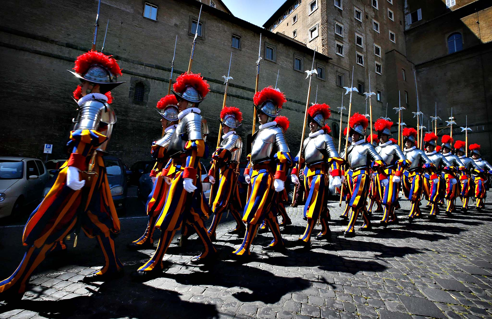 New recruits of the Vatican's elite Swiss Guard march during the swearing-in ceremony at the Vatican  May 6, 2014. The Swiss Guard, founded in 1506, consist of 100 volunteers who must be of Swiss nationality, Catholic, single, at least 174 cm (5.7 ft) tall and without a beard. New recruits are sworn in every year on May 6 to commemorate the day where 147 Swiss soldiers died defending the Pope during an attack on Rome in 1527.