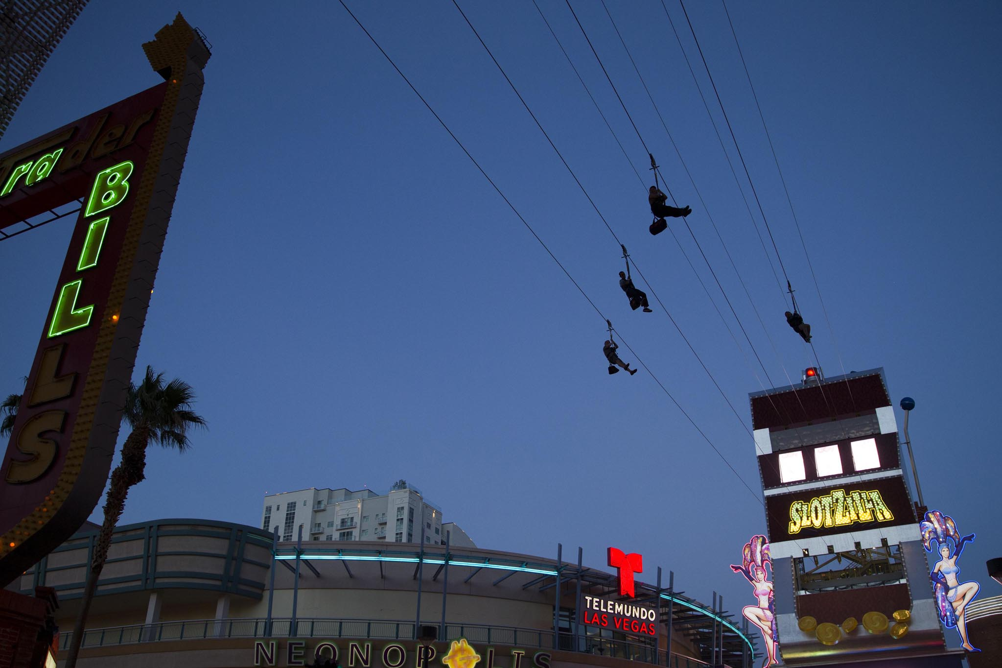 People try out the new 850-foot-long SlotZilla Zipline at the Fremont Street Experience in downtown Las Vegas