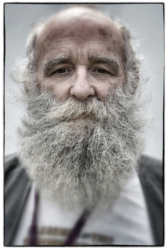 Glastonbury Festival Alternative View: Beard Popularity...GLASTONBURY, ENGLAND - JUNE 26:  (Editor's note: Image has been processed using a digital filter) Festival property lock-up manager Graham Allen poses for a photograph at the 2014 Glastonbury Festival on June 26, 2014 in Glastonbury, England. The 65-year-old, who has been running the CND property lock-up since 1989 has been growing his beard since he was 27. Many fashion commentators are claiming that beards have peaked in 2014 and the era of fashionable facial hair may be coming to an end. And research by the wet shave subscription service, Cornerstone, shows that Glastonbury 2014 may be the hairiest year since 1981 thanks to such headliners as Kasabian and Metallica playing the Pyramid stage. The researchers claim that 'peak beard' periods at Glastonbury have famously lead to a decline in societal hairiness, and believe that 2014 will mark the death of the beard and a new era of well-groomed music lovers.  (Photo by Matt Cardy/Getty Images)