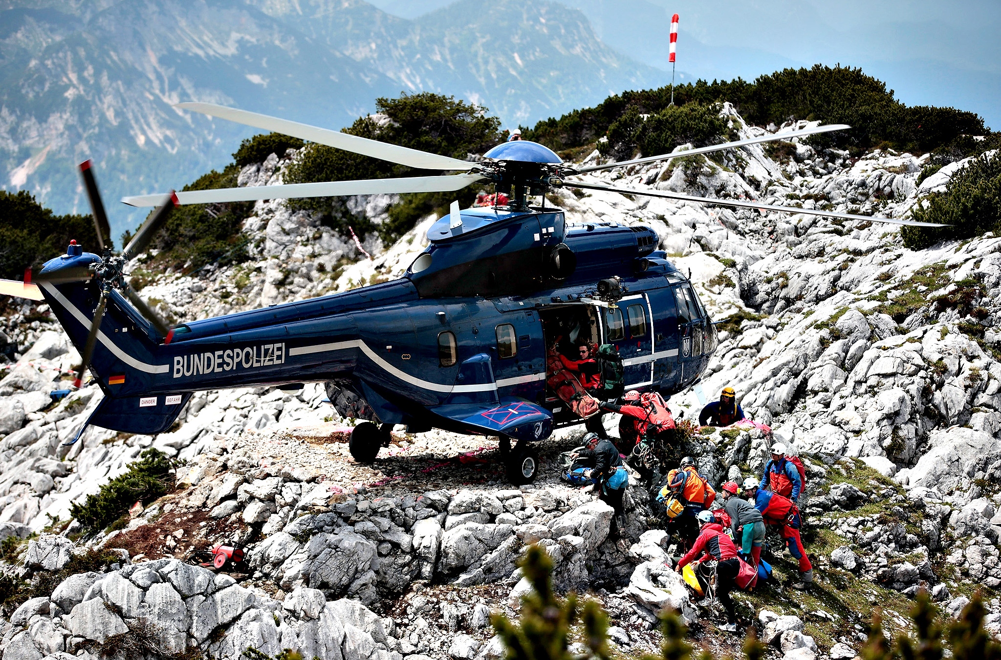 Rescue workers transport equipment into a police helicopter near the entrance to the Riesending vertical cave after the final phase of the transport of injured spelunker Johann Westhauser to the surface on June 19, 2014 near Marktschellenberg, Germany. Westhauser received a severe head injury when he was struck by rocks in the cave on June 8, 1,000 meters below the surface, and emergency crews from Germany, Italy and other nations have been working around the clock in an arduous effort to save him. Westhauser was among explorers who first discovered the cave, which is over 20 kilometers long, in 1995.