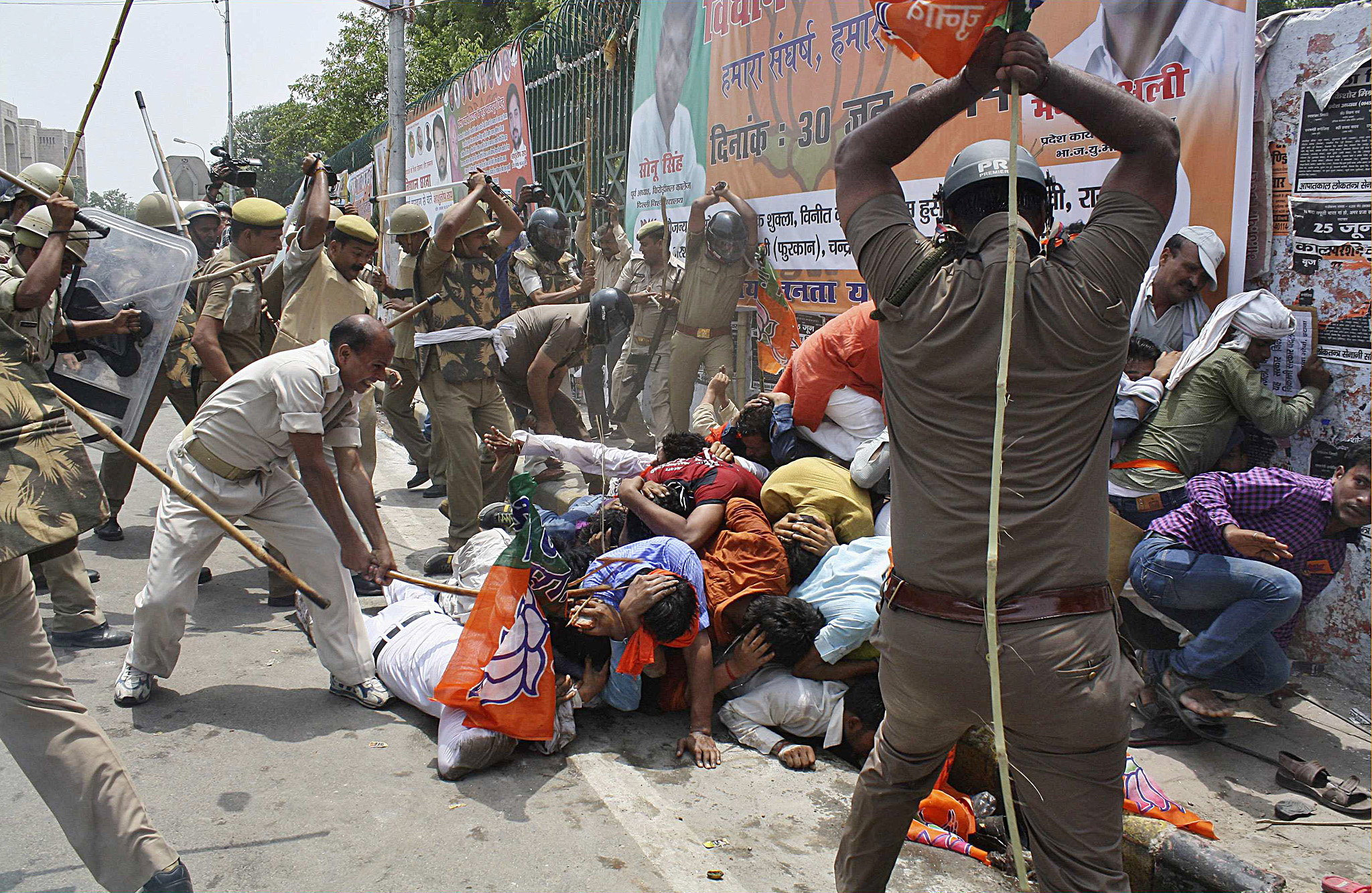 "ATTENTION EDITORS - REUTERS PICTURE HIGHLIGHT TRANSMITTED BY 1350 GMT ON JUNE 30, 2014  DEL04 Indian policemen use batons to disperse youth wing workers of India's ruling Bharatiya Janata Party (BJP) during a protest outside the state assembly in the northern Indian city of Lucknow. REUTERS/Pawan Kumar   REUTERS NEWS PICTURES HAS NOW MADE IT EASIER TO FIND THE BEST PHOTOS FROM THE MOST IMPORTANT STORIES AND TOP STANDALONES EACH DAY. Search for ""TPX"" in the IPTC Supplemental Category field or ""IMAGES OF THE DAY"" in the Caption field and you will find a selection of 80-100 of our daily Top Pictures.  REUTERS NEWS PICTURES.   TEMPLATE OUT"