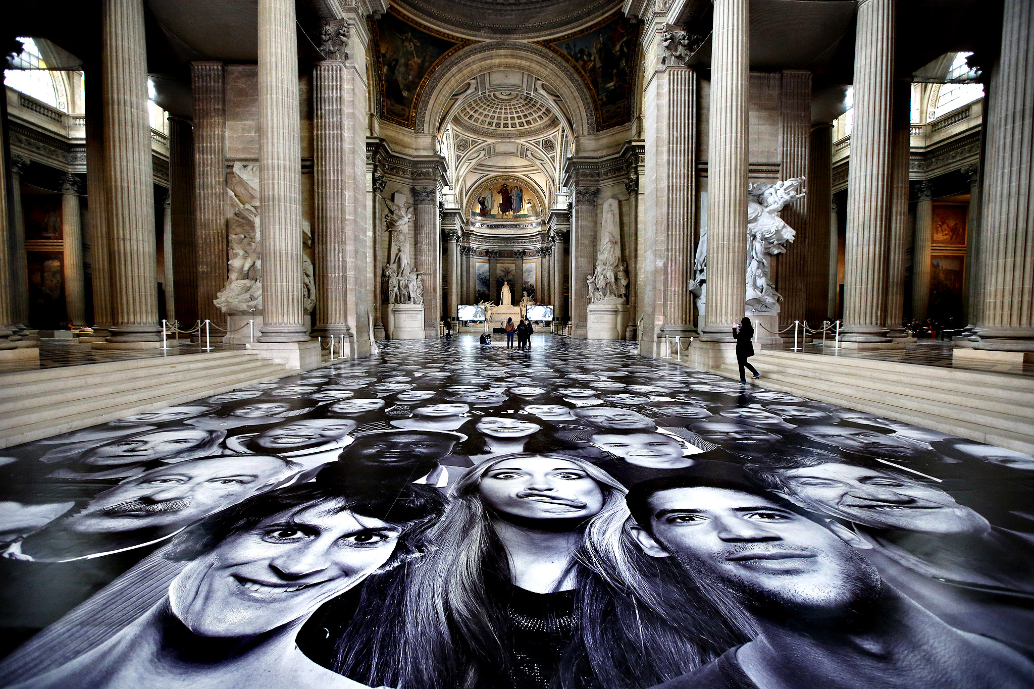 Giant portraits by French street artist and photographer JR are pictured during the presentation of his creation at the Pantheon in Paris, Tuesday, June 3, 2014. French Government named JR to decorate with portraits the dome of Paris' Pantheon, that is the final resting place for 72 of France's renowned men, and just one woman, as the monument is undergoing a 2 year renovation.