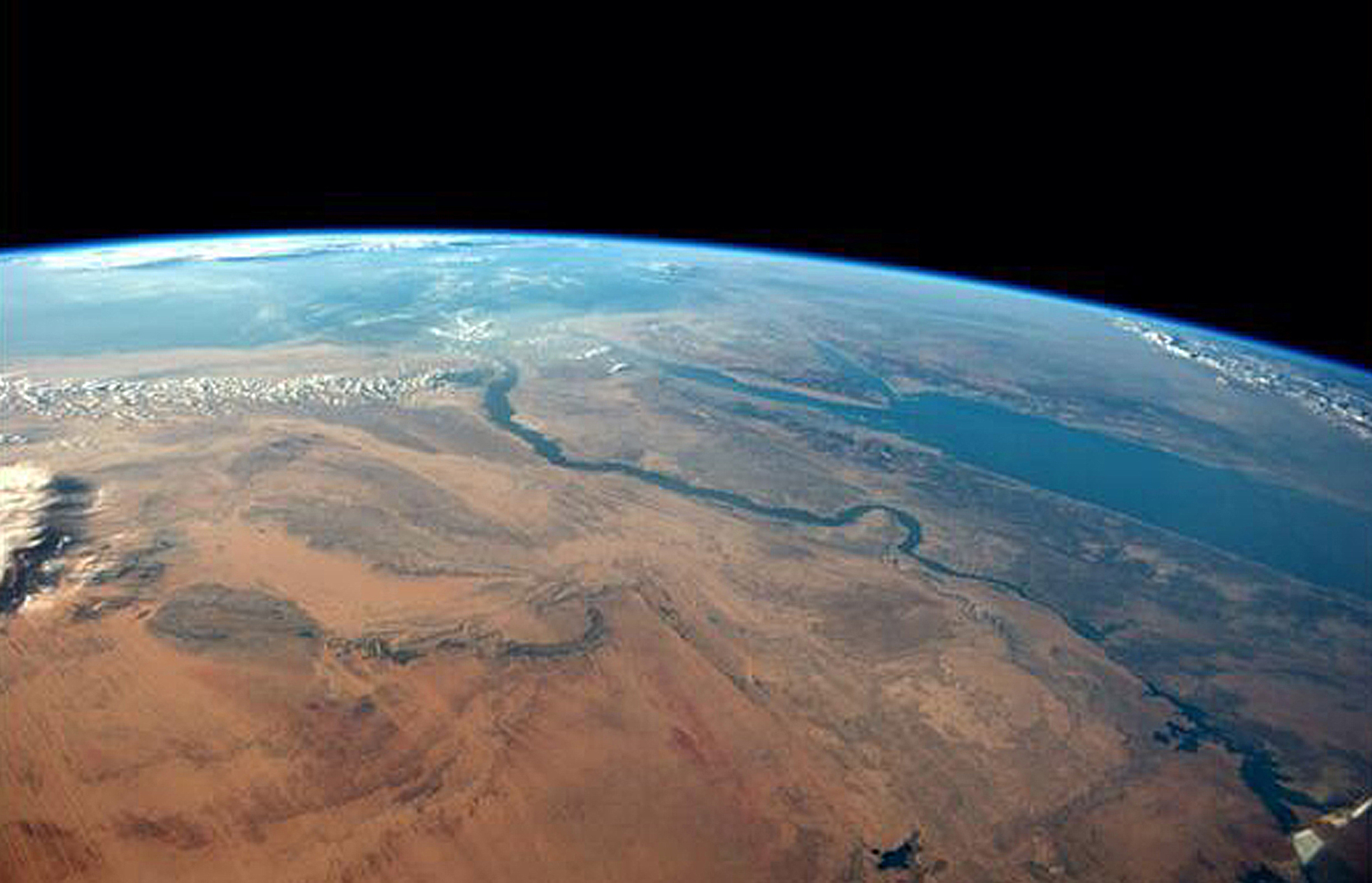 Egyptian desert meets the Red Sea on a cloudless afternoon in this photo tweeted by first-time astronaut Reid Wiseman...The Egyptian desert meets the Red Sea on a cloudless afternoon in this photo tweeted by first-time astronaut Reid Wiseman on June 8, 2014. Wiseman is one of six men living aboard the International Space Station. Wiseman is sharing his observations and pictures with a growing following on Twitter.  REUTERS/Reid Wiseman/NASA/Handout via Reuters  (OUTER SPACE - Tags: ENVIRONMENT SCIENCE TECHNOLOGY TPX IMAGES OF THE DAY) ATTENTION EDITORS - FOR EDITORIAL USE ONLY. NOT FOR SALE FOR MARKETING OR ADVERTISING CAMPAIGNS. THIS PICTURE WAS PROVIDED BY A THIRD PARTY. REUTERS IS UNABLE TO INDEPENDENTLY VERIFY THE AUTHENTICITY, CONTENT, LOCATION OR DATE OF THIS IMAGE. THIS PICTURE IS DISTRIBUTED EXACTLY AS RECEIVED BY REUTERS, AS A SERVICE TO CLIENTS