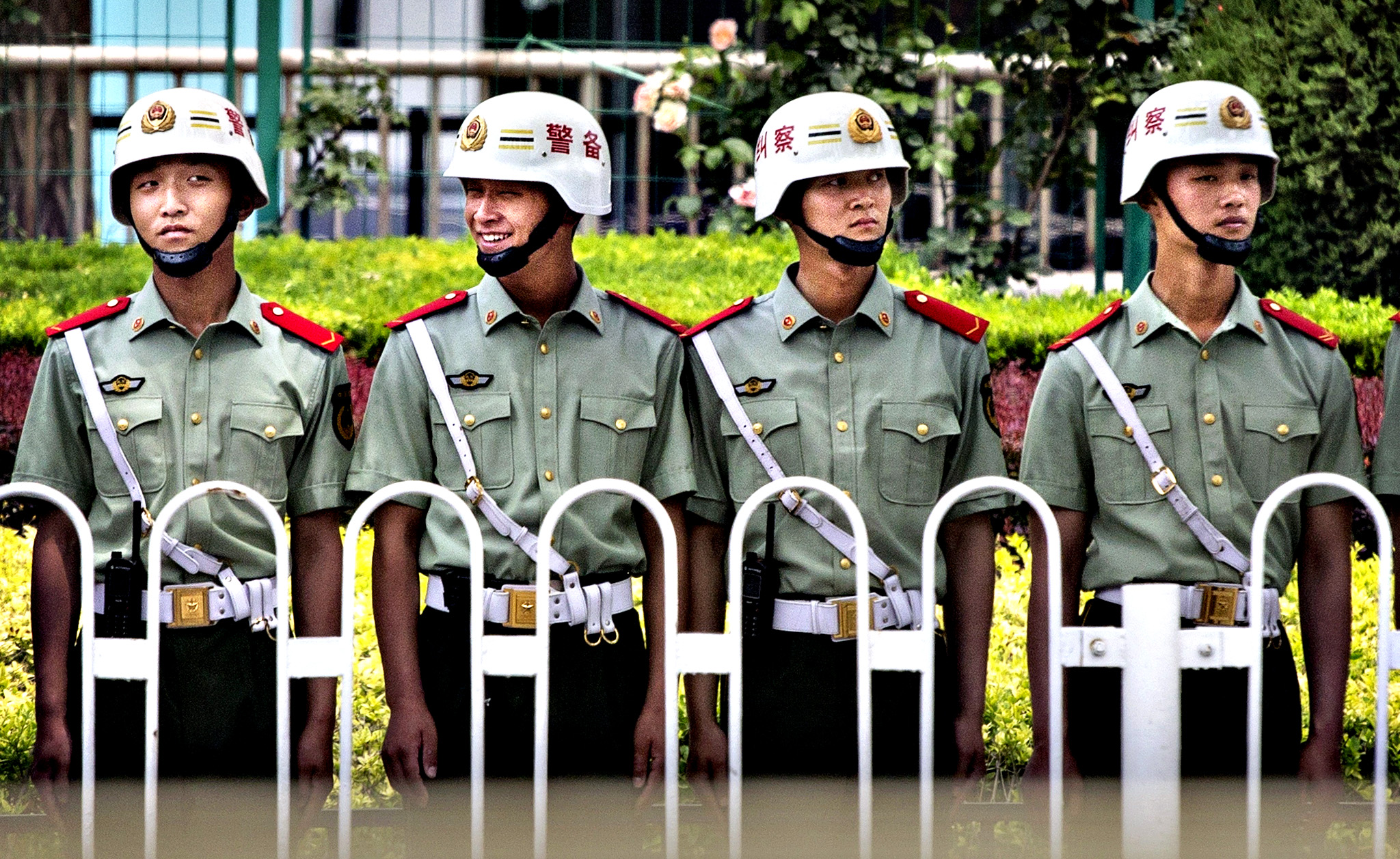 Tiananmem Square Anniversary...BEIJING, CHINA - JUNE 03:  Chinese Paramilitary police stand guard near Tiananmen Square on June 4, 2014 in Beijing, China. Twenty-five years ago on June 4, 1989 Chinese troops cracked down on pro-democracy protesters and in the clashes that followed scores were killed and injured.