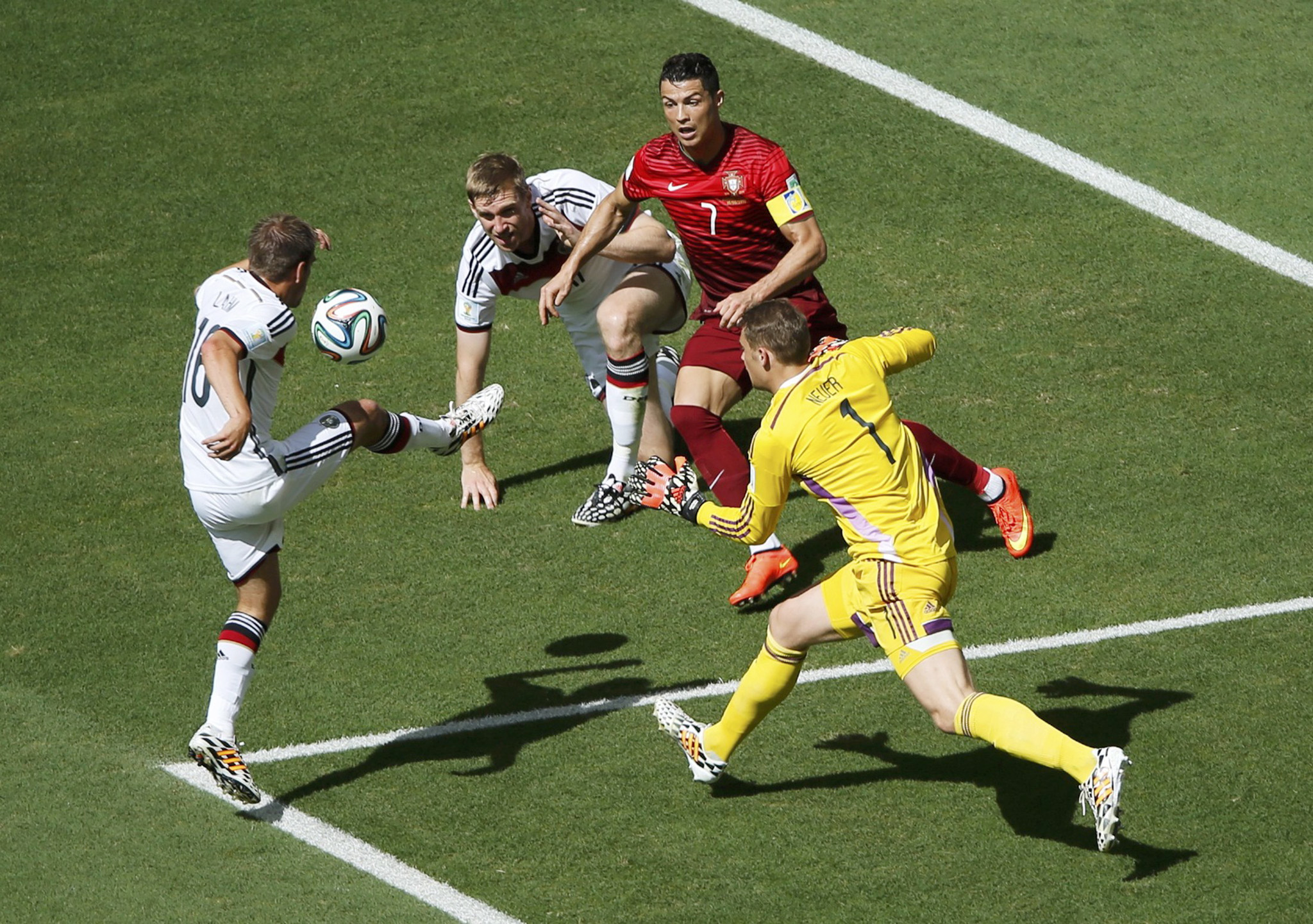 Portugal's Ronaldo fights for the ball with Germany's Lahm, Mertesacker and Neuer during their 2014 World Cup Group G soccer match at the Fonte Nova arena in Salvador...Portugal's Cristiano Ronaldo (2nd R) fights for the ball with Germany's Philipp Lahm (L-R), Per Mertesacker and Manuel Neuer during their 2014 World Cup Group G soccer match at the Fonte Nova arena in Salvador June 16, 2014.  REUTERS/Fabrizio Bensch (BRAZIL  - Tags: SOCCER SPORT WORLD CUP)