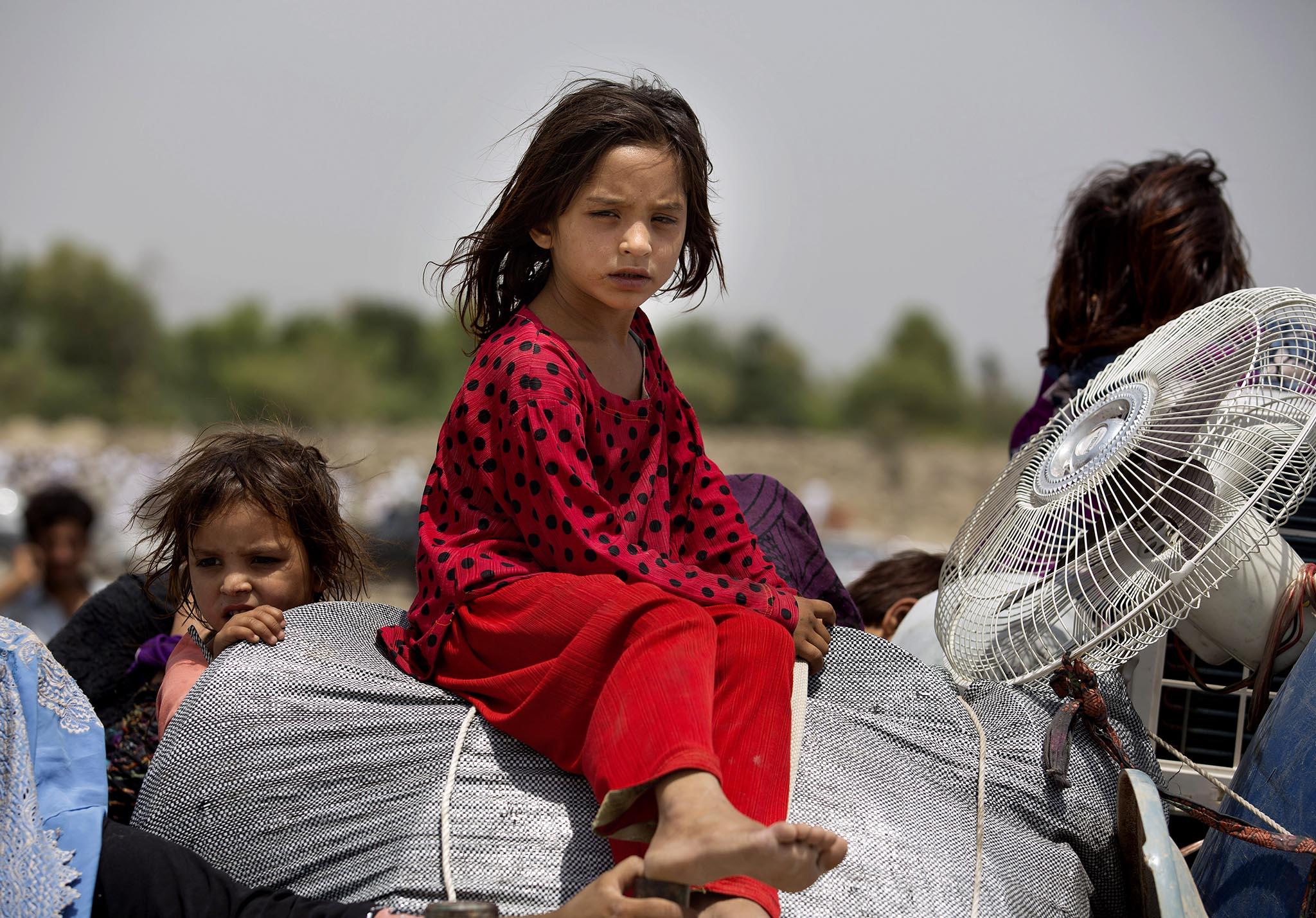 Pakistani tribal people arrive in Bannu, Pakistan,