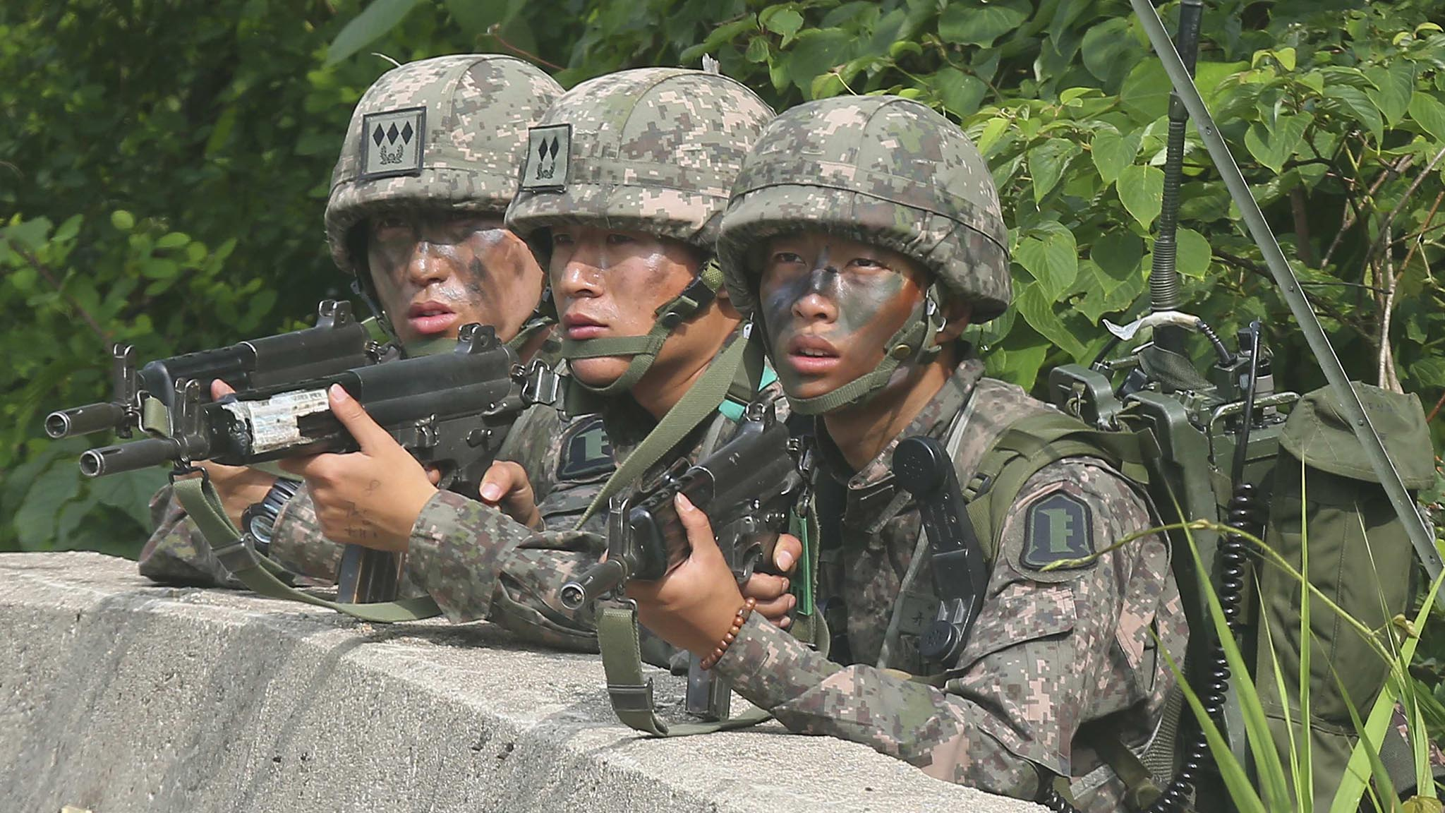 South Korean soldiers take position during a search and arrest operation as troops standoff with a conscript soldier in Goseong