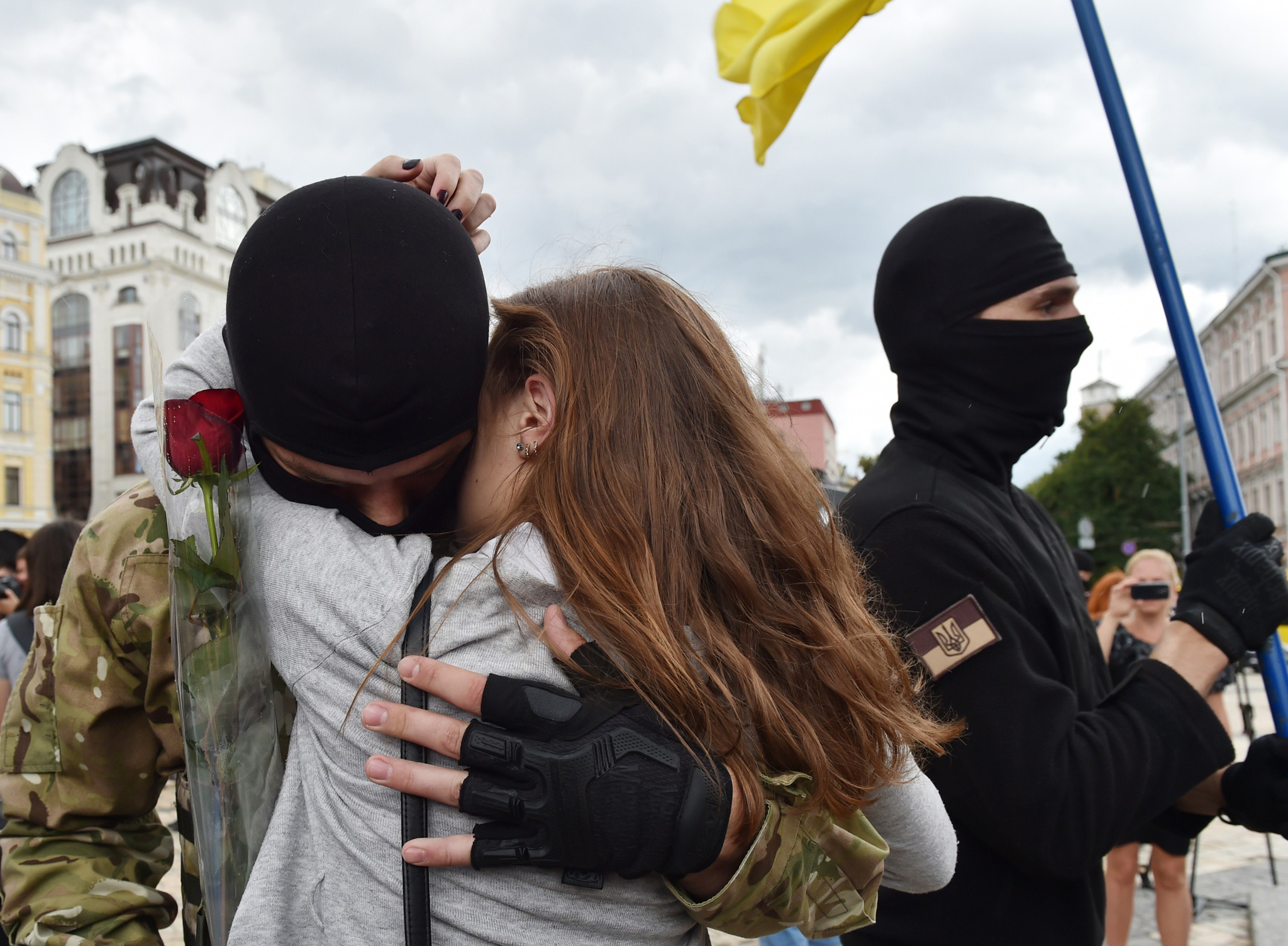 A girl cries as she embraces her boyfriend, a new volunteer recruit of the Ukrainian army's 'Azov' battalion, after a military oath ceremony in Kiev.