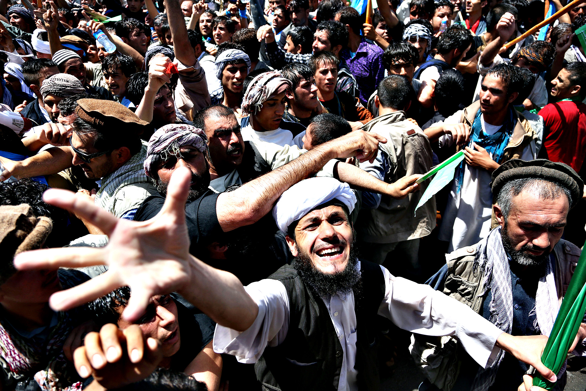 Supporters of Afghan presidential candidate Abdullah Abdullah chant slogans during a protest in Kabul, Afghanistan, Friday, June 27, 2014. Afghanistan's security situation has been complicated by a political crisis stemming from allegations of massive fraud in the recent election to replace President Hamid Karzai, the only leader the country has known since the Taliban regime was ousted nearly 13 years ago. Abdullah Abdullah, one of two candidates who competed a runoff vote on June 14 suspended his relations with the Independent Election Commission after he accused electoral officials of engineering extensive vote rigging, allegations they have denied