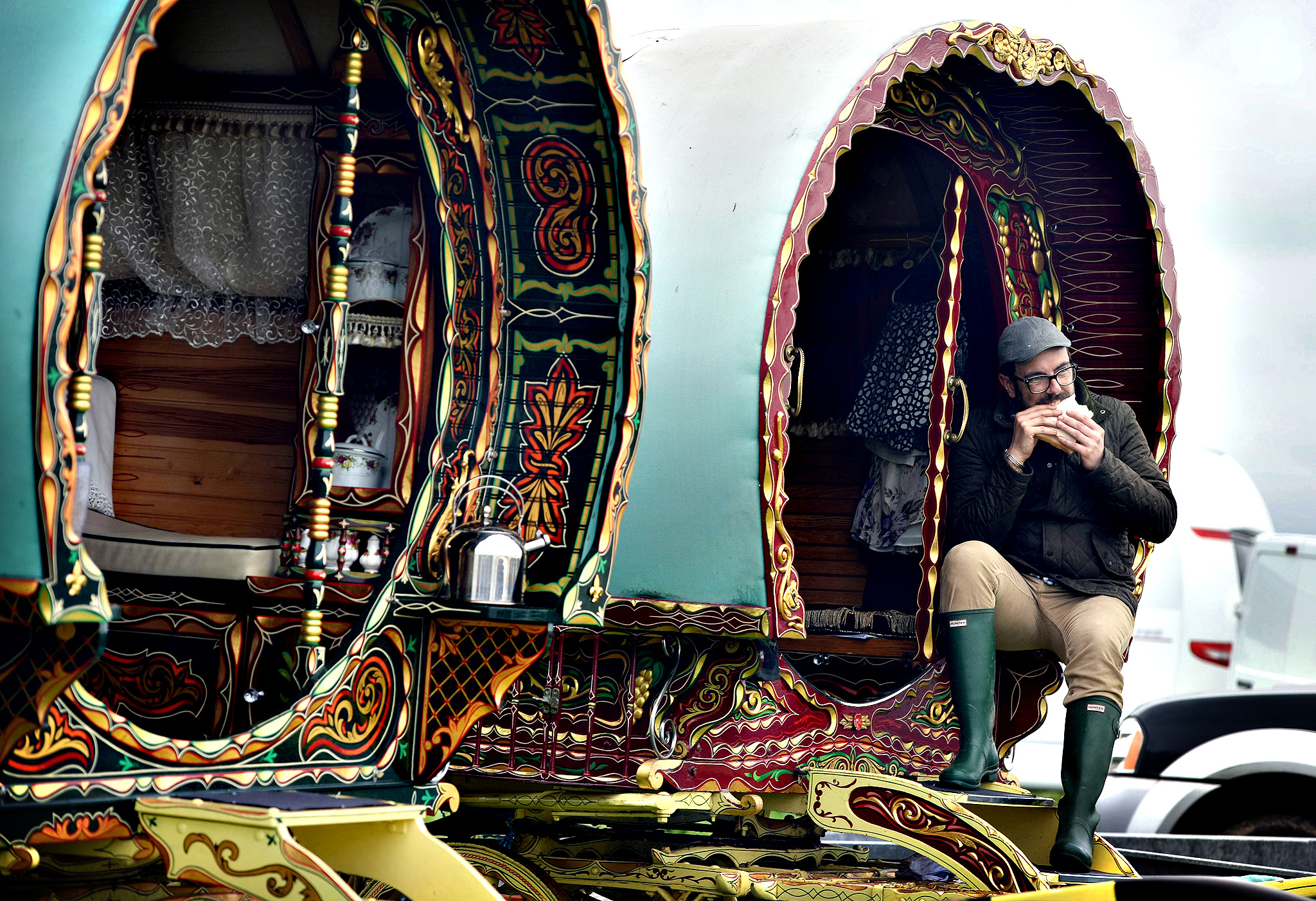 A man sits in his caravan during the Appleby Horse Fair on June 5, 2014 in Appleby, England. The Appleby Horse Fair has existed under the protection of a charter granted by James II since 1685 and is one of the key gathering points for the Romany, gypsy and traveling community. The fair is attended by about 5,000 travellers who come to buy and sell horses. The animals are washed and groomed before being ridden at high speed along the 'mad mile' for the viewing of potential buyers.