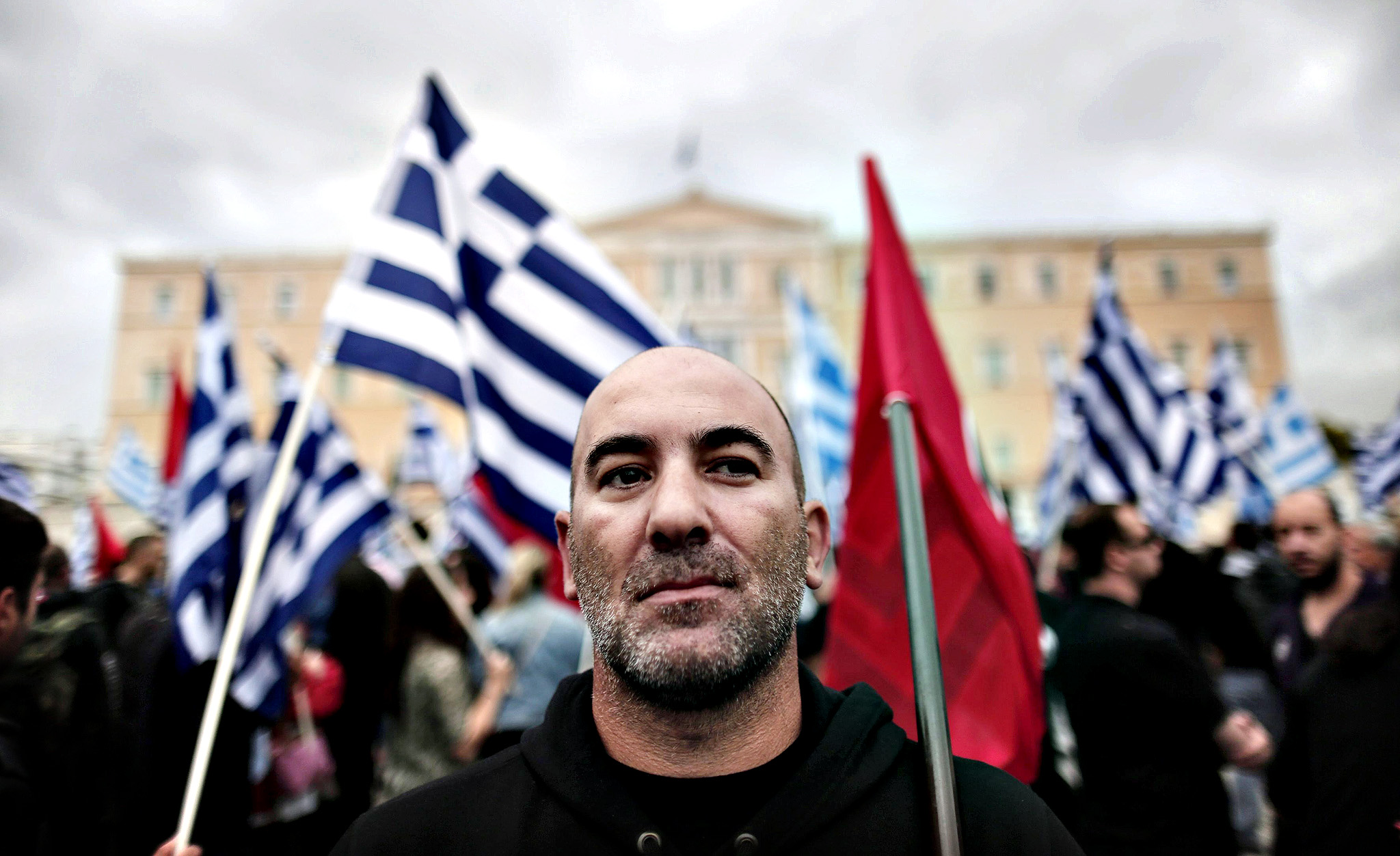 Far-right Golden Dawn party supporters demonstrate in front of the Parliament before a vote that will decide whether the deputies of the party will be stripped of their immunity from prosecution, in Athens, Greece, 04 June 2014. The members of Parliament (MP) of the Golden Dawn party are being charged for their alleged participation and leading of a criminal organization
