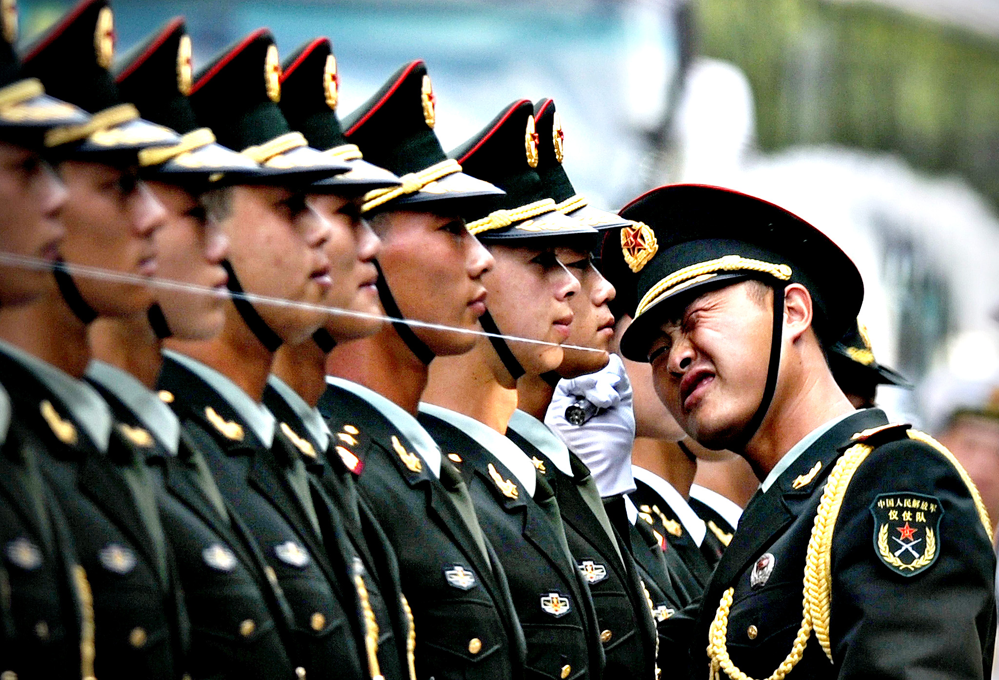 Chinese honour guards prepare for the arrival of Myanmar President U Thein Sein and Chinese President Xi Jinping during a welcome ceremony outside the Great Hall of the People in Beijing on June 27,2014. U Thein Sein is on a visit to China from June 27 to 30.