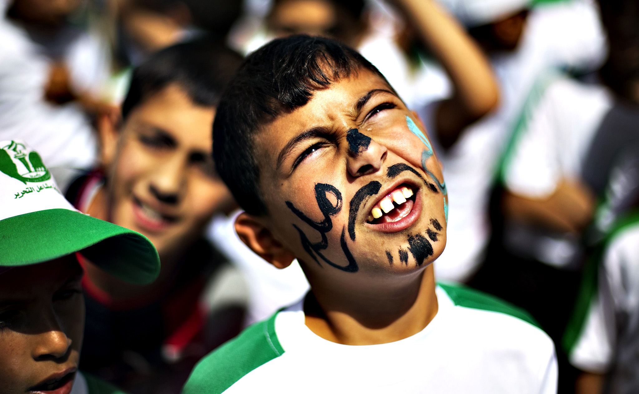 Palestinian children take part in a summer camp organized by Hamas on June 3, 2014. Thousands of elementary school students in the Gaza Strip are going to Hamas summer camps, in which they take part in recreational activities and participate in political demonstrations in solidarity with Palestinian prisoners held in Israeli jails.