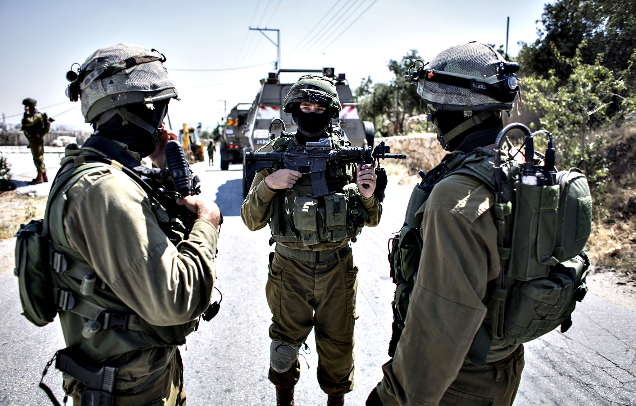 An Israeli soldier conducts a search mission during the sixth day into the search of three missing teenagers June 18, 2014 in Hebron, West Bank. Israeli soldiers have so far detained more than 210 suspects in the search for three teenagers who went missing in Jewish settlements in the West Bank late last week.