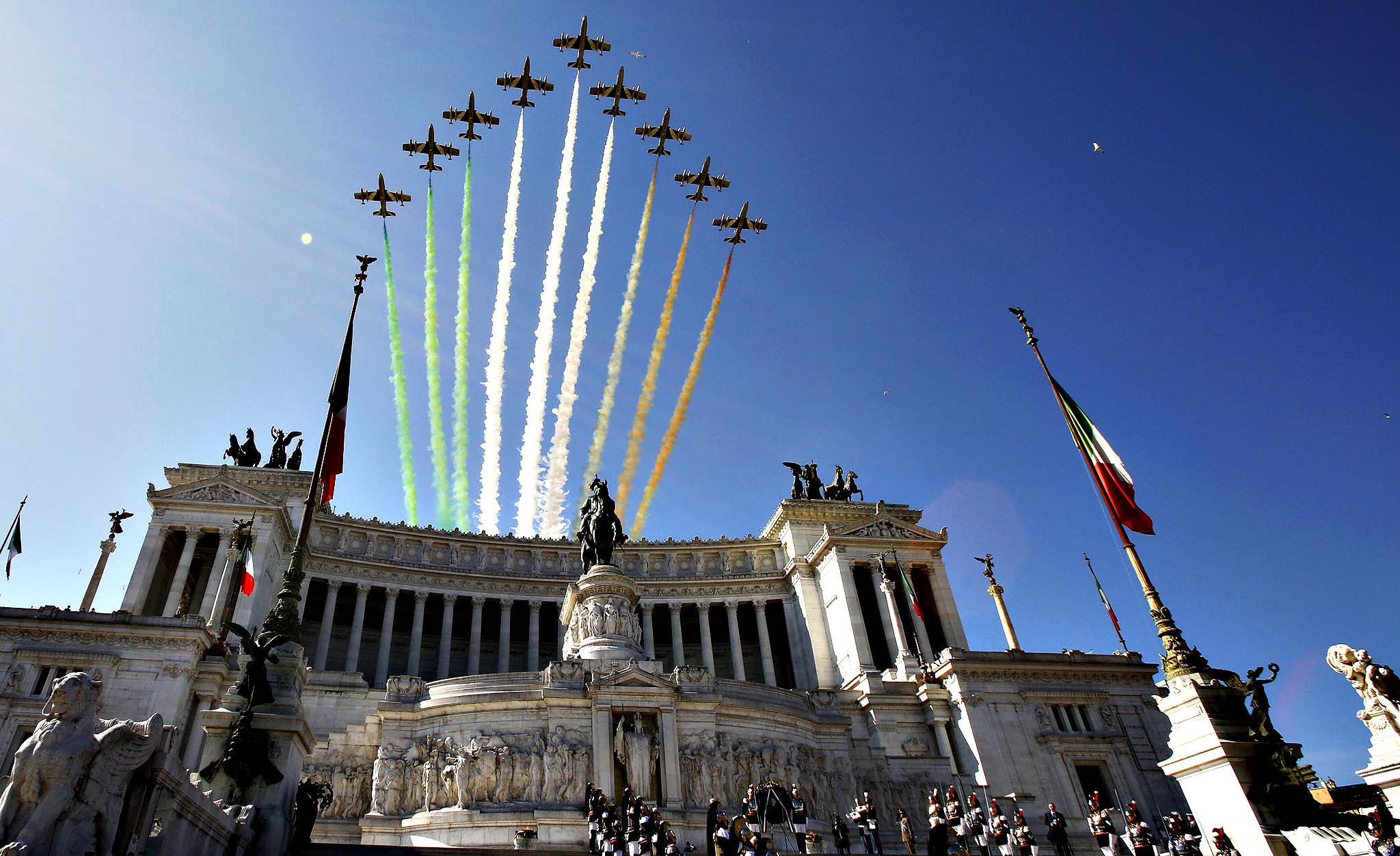 """The Frecce Tricolori (three-color arrows) Italian Air Force acrobatic squad fly above the """"Vittoriano"""", the Unknown Soldier monument, on the occasion of the Republic Day military parade, in Rome, Monday, June 2, 2014. The Republic Day marks the anniversary of the birth of the Italian Republic after a referendum held on June 2, 1946 in which Italians chose the form of government between monarchy and republic following WWII."""