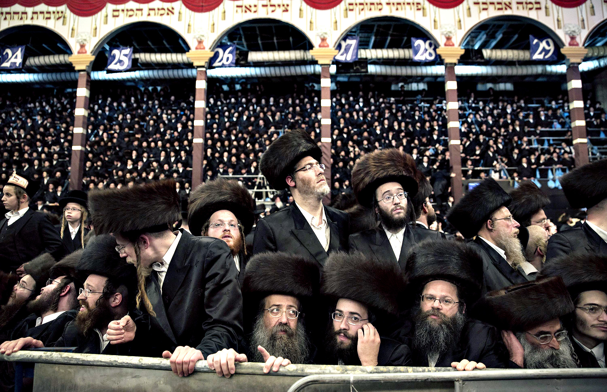 Ultra-orthodox Jews take part in celebrations after the wedding ceremony of Esther Rokeach and Avraham Safrin (not pictured) in Jerusalem June 11, 2014. Thousands gathered on Tuesday to celebrate the wedding between Safrin and Rokeach, the granddaughter of the spiritual leader of the Belz Hasidim, which is one of the largest Hasidic movements in the world.