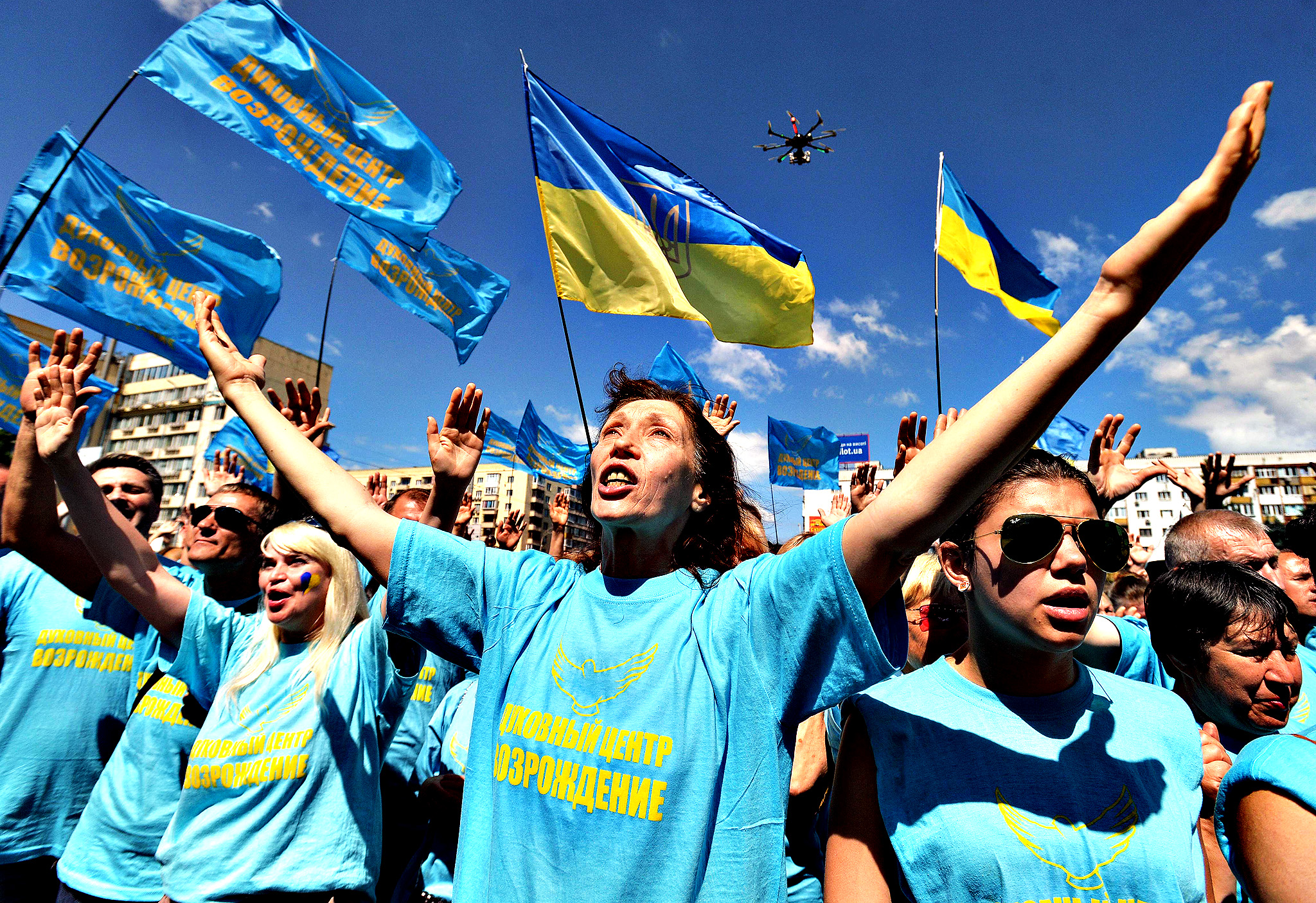 People take part in a mass prayer for peace in downtown Kiev on June 19, 2014. Ukraine's new Western-backed president announced plans on JUne 18 to order a unilateral ceasefire in the separatist east that could help end a bloody pro-Russian insurgency and avert his ex-Soviet country's breakup.