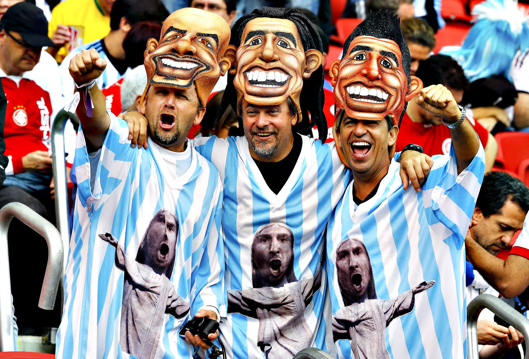 Argentinian fans wear masks as they attend the 2014 World Cup Group F soccer match against Nigeria at the Beira Rio stadium in Porto Alegre June 25, 2014.