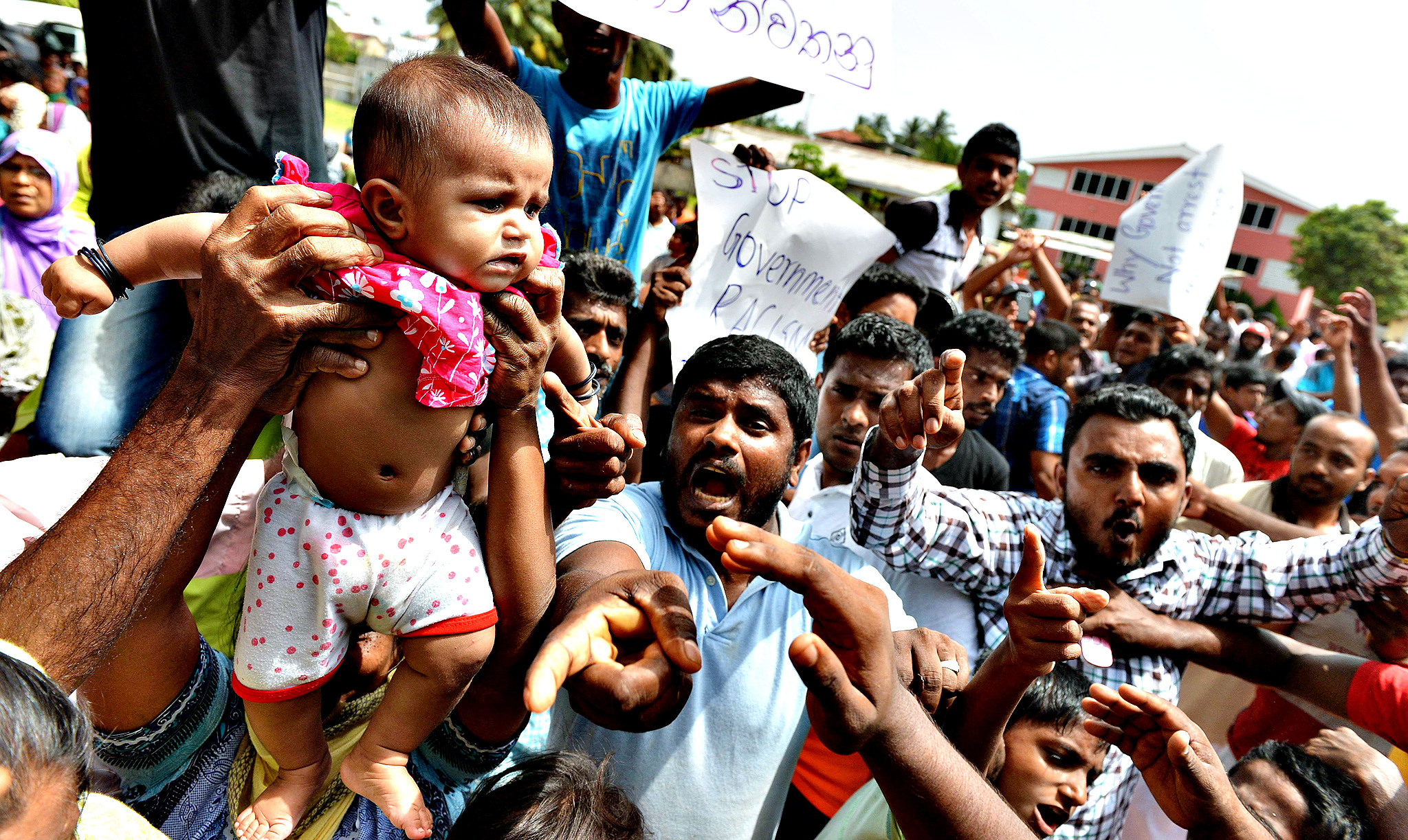 Sri Lankan muslims, made homeless after two days of anti-muslim riots in Sri Lankas tourist region of Alutgama, demonstrate against radical Buddhist group Bodu Bala Sena (BBS)at a makeshift camp in Beruwala, about 58 kms south of capital Colombo on June 18, 2014.  The Buddhist Force, or BBS, is widely accused of leading the violence. The main Muslim party in Sri Lanka's ruling coalition, Sri Lanka Muslim Congress (SLMC), demanded a UN probe into one of the worst religious riots as President Mahinda Rajapakse toured the violence-hit resort region.