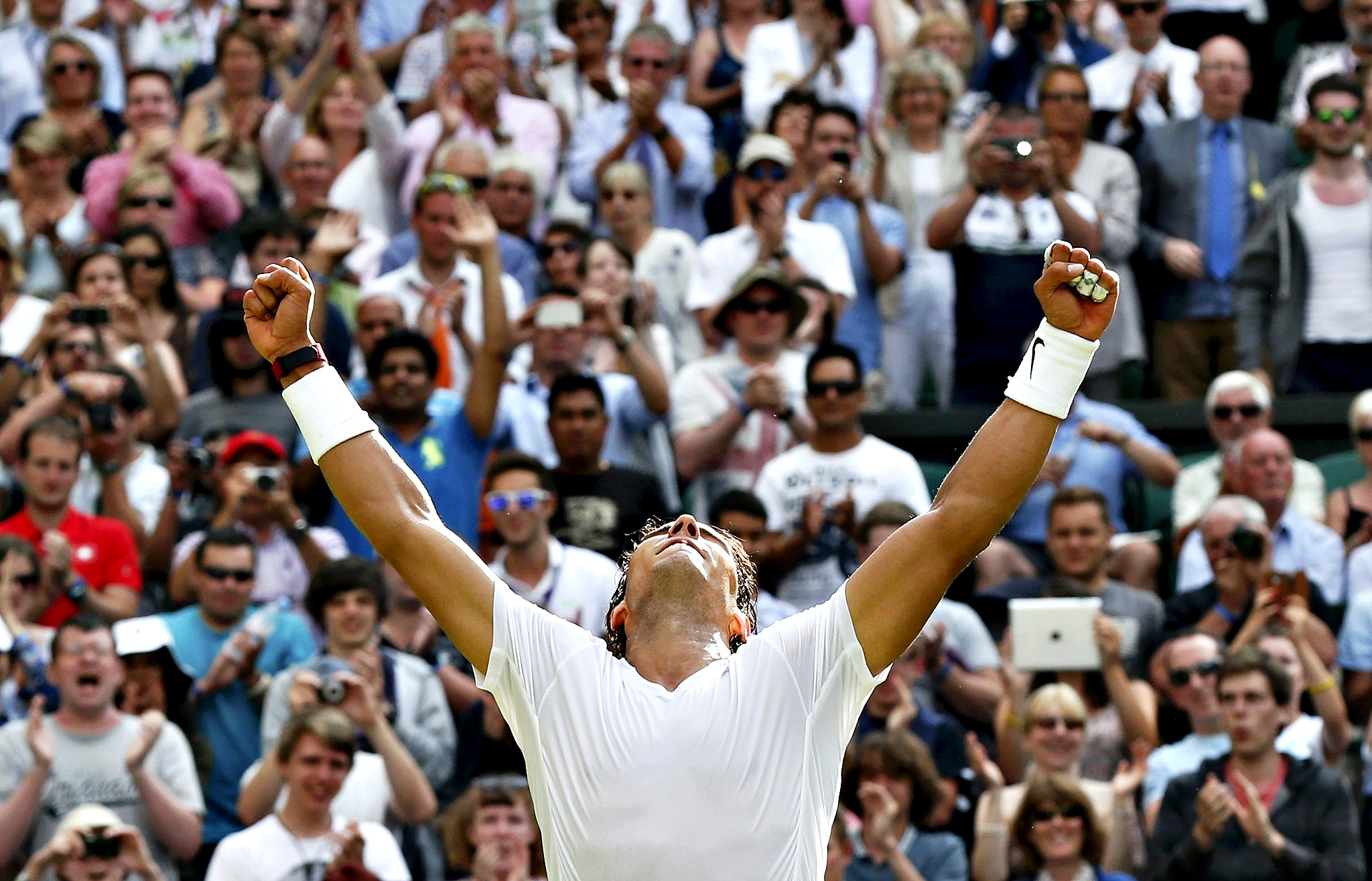 Rafael Nadal of Spain reacts after defeating Martin Klizan of Slovaki in their men's singles tennis match at the Wimbledon Tennis Championships, in London...Rafael Nadal of Spain reacts after defeating Martin Klizan of Slovaki in their men's singles tennis match at the Wimbledon Tennis Championships, in London June 24, 2014.