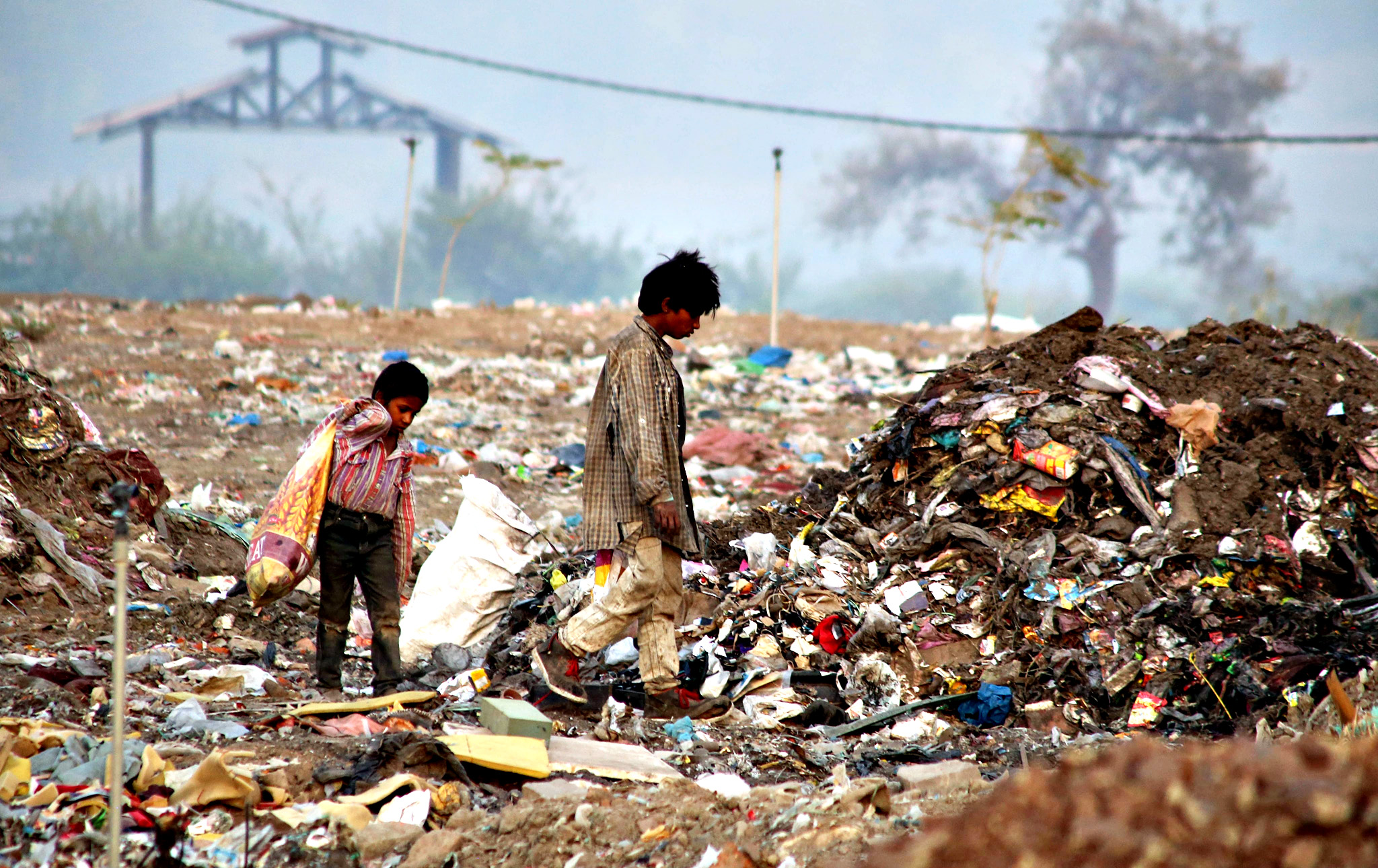 Ragpickers collect usable material from a garbage dumping ground on the eve of  World Environment Day, in Bhopal, India, 04 June 2014. World Enviornment Day is marked every year on 05 June to raise global awareness of the need to take positive environmental action.