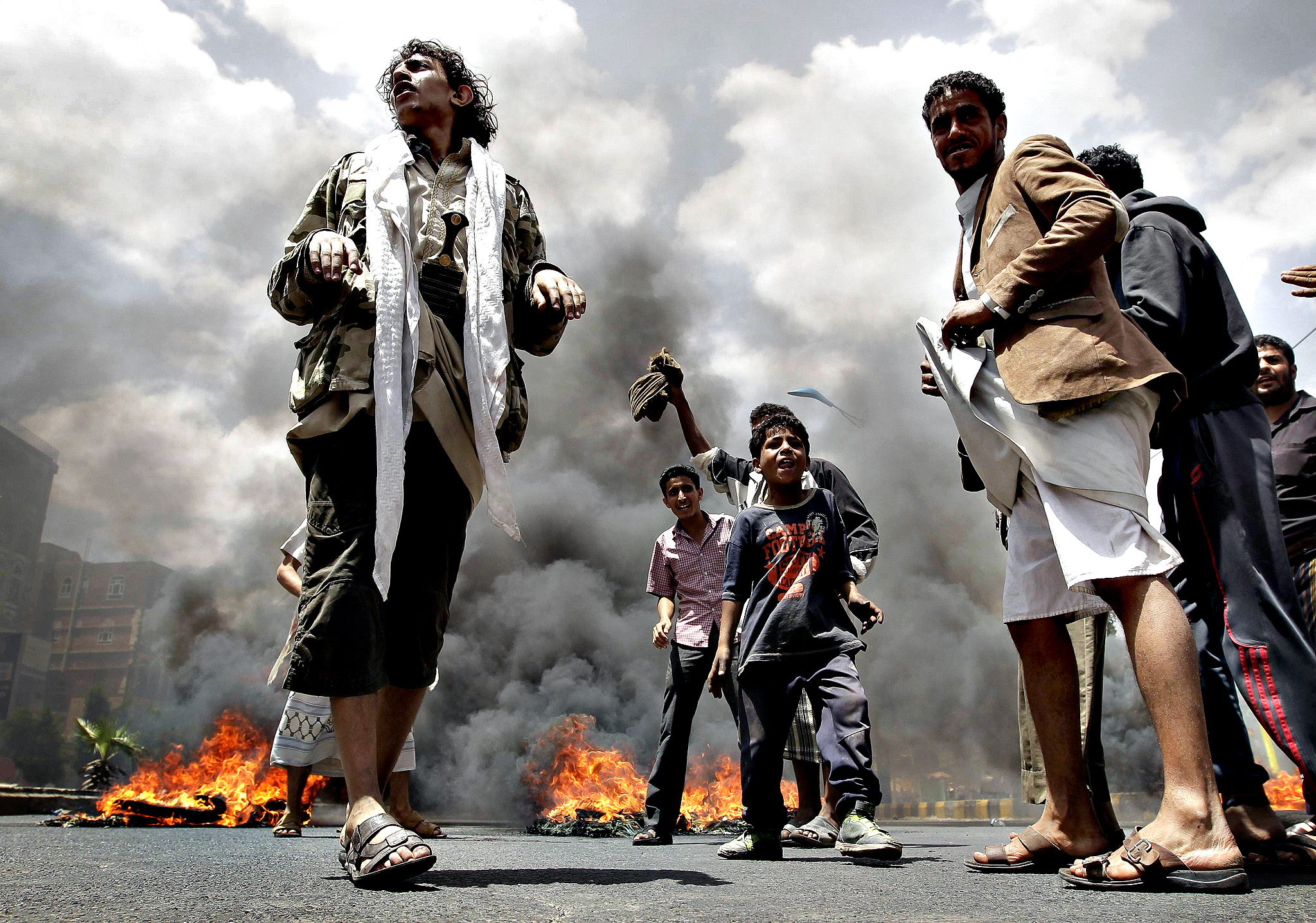 Protesters burn tyres during a demonstration against against Yemen's fuel shortages near the house of President Abdu Rabbu Mansour Hadi in Sanaa...Protesters burn tyres during a demonstration against against Yemen's fuel shortages near the house of President Abdu Rabbu Mansour Hadi in Sanaa June 11, 2014.