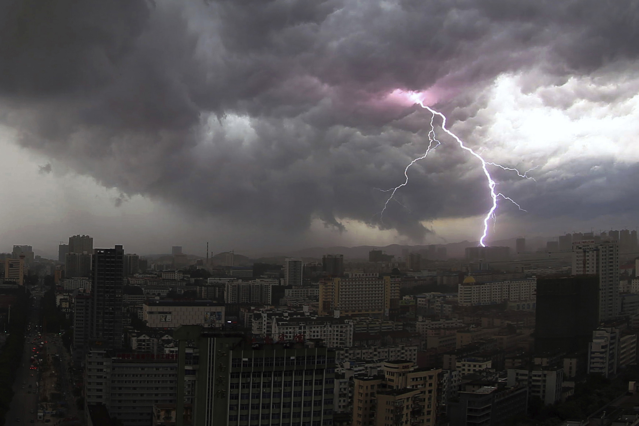 A streak of lightning is seen above the skyline of Nanning during a thunderstorm...A streak of lightning is seen above the skyline of Nanning during a thunderstorm in Guangxi Zhuang Autonomous region June 5, 2014. Picture taken June 5, 2014. REUTERS/Stringer (CHINA - Tags: ENVIRONMENT CITYSCAPE) CHINA OUT. NO COMMERCIAL OR EDITORIAL SALES IN CHINA