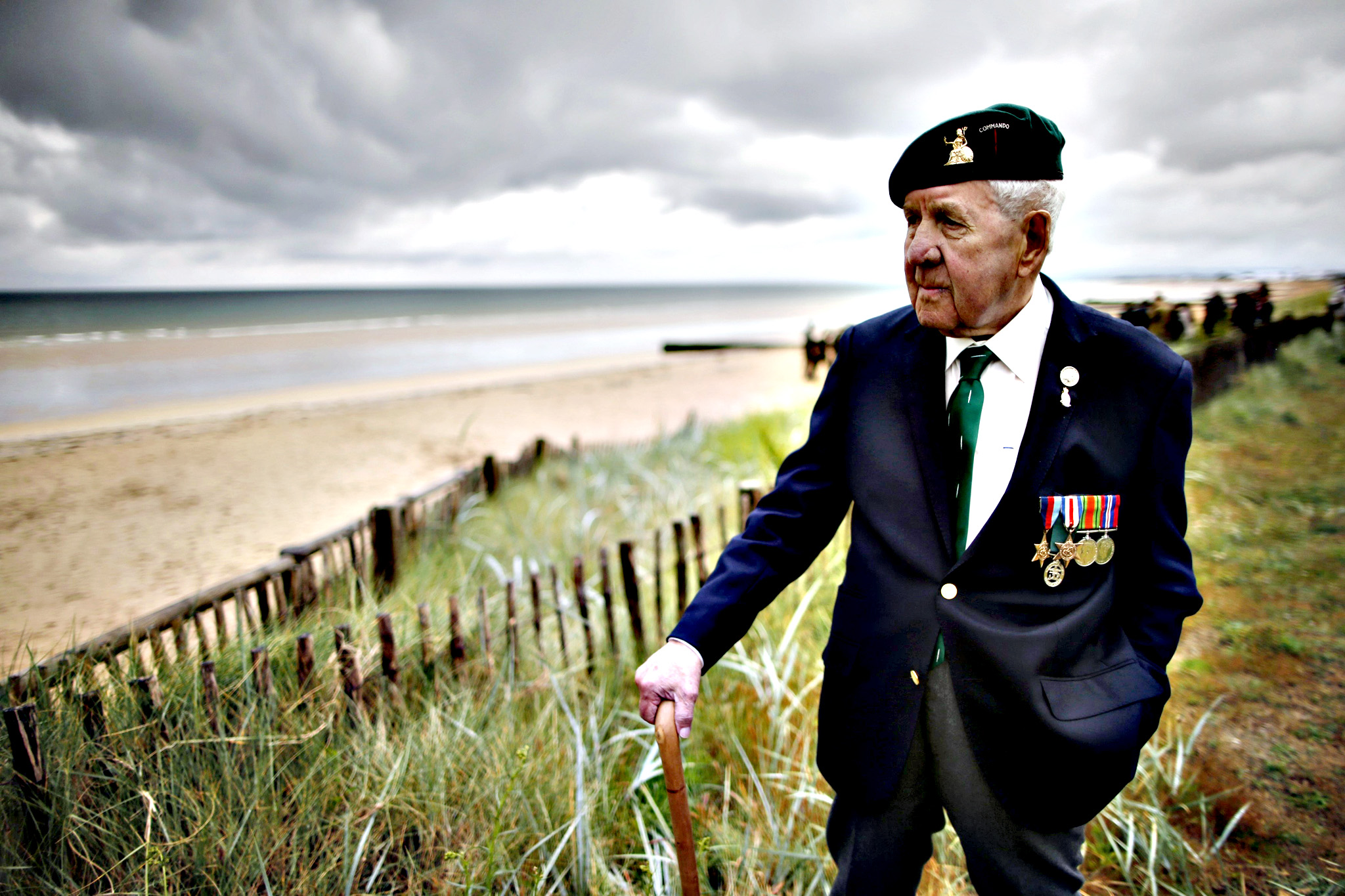World War II veteran Herbert Beddows, 92 years-old from Britain who served with three different commandos and landed on Sword Beach on June 6, 1944, poses on the beach front outside Colleville-Montgomery