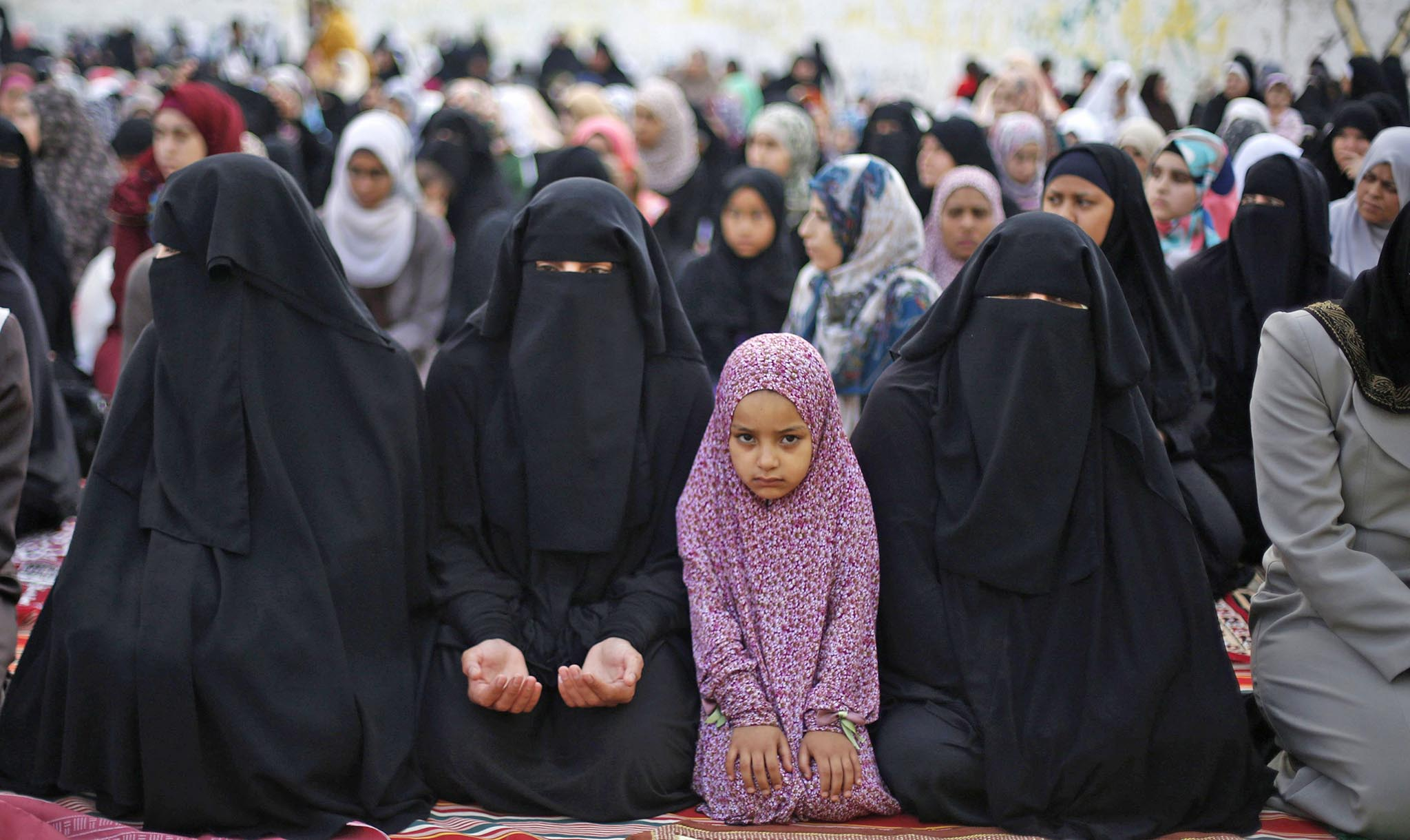 Palestinian refugees perform Eid al-Fitr prayers at Al-Baqaa Palestinian refugee camp, near Amman
