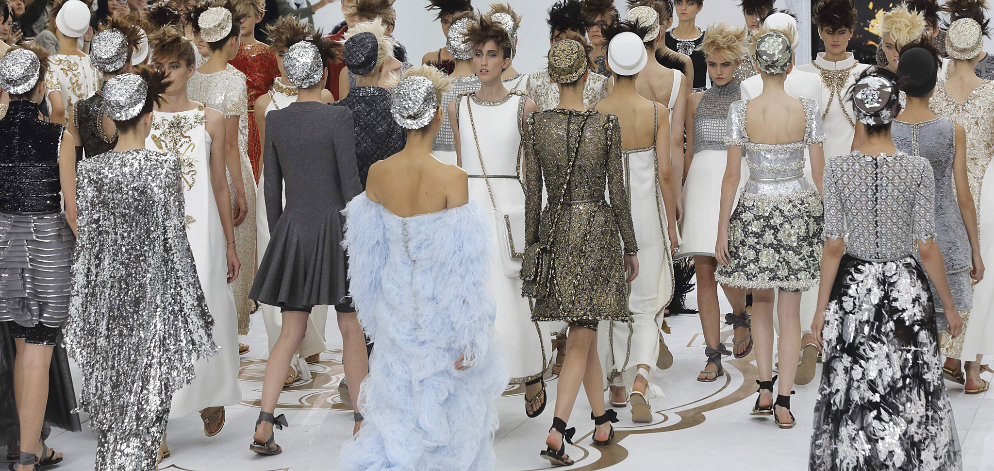 Models present creations by German designer Karl Lagerfeld at the end of his Haute Couture Fall/Winter 2014-2015 fashion show for French fashion house Chanel in Paris...Models present creations by German designer Karl Lagerfeld at the end of his Haute Couture Fall/Winter 2014-2015 fashion show for French fashion house Chanel in Paris July 8, 2014. REUTERS/Philippe Wojazer (FRANCE - Tags: FASHION)
