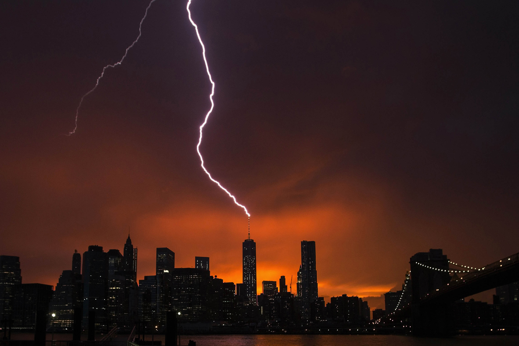 "REUTERS PICTURE HIGHLIGHT...ATTENTION EDITORS - REUTERS PICTURE HIGHLIGHT TRANSMITTED BY 0131 GMT ON JULY 3, 2014    LJJ015  Lightning strikes One World Trade Center in Manhattan as the sun sets behind the city after a summer storm in New York.  REUTERS/Lucas Jackson     REUTERS NEWS PICTURES HAS NOW MADE IT EASIER TO FIND THE BEST PHOTOS FROM THE MOST IMPORTANT STORIES AND TOP STANDALONES EACH DAY. Search for ""TPX"" in the IPTC Supplemental Category field or ""IMAGES OF THE DAY"" in the Caption field and you will find a selection of 80-100 of our daily Top Pictures.    REUTERS NEWS PICTURES.     TEMPLATE OUT"
