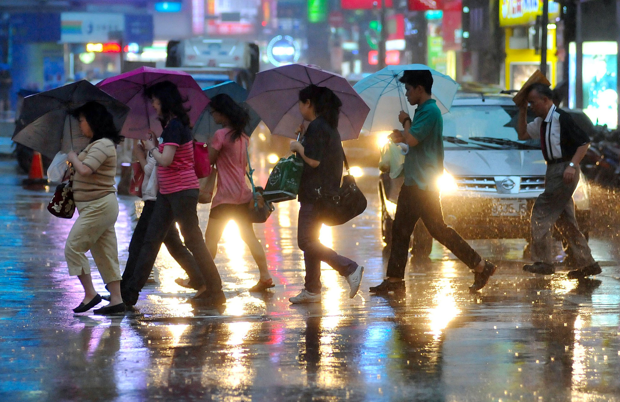 Pedestrians shield themselves from the r...Pedestrians shield themselves from the rain with umbrellas as they cross a street in Taipei on July 22, 2014 as Typhoon Matmo approaches eastern Taiwan. Typhoon Matmo churned towards Taiwan on July 22, picking up strength with thousands of tourists evacuated from outlying islands as weather forecasters warned of possible flash floods and landslides.   AFP PHOTO / Mandy CHENGMandy Cheng/AFP/Getty Images