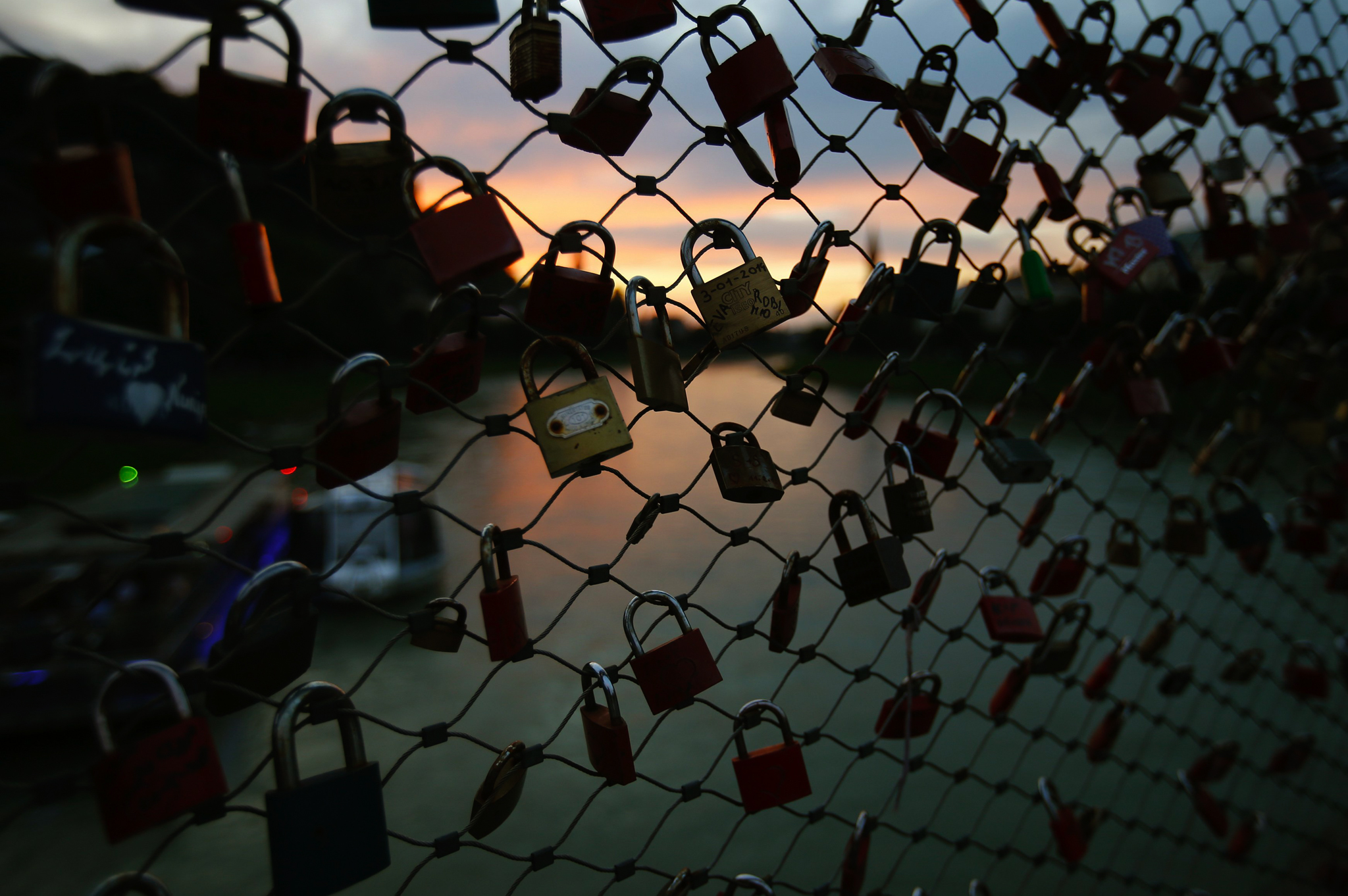 Love locks on a bridge over the river Salzach in Salzburg, Austria.