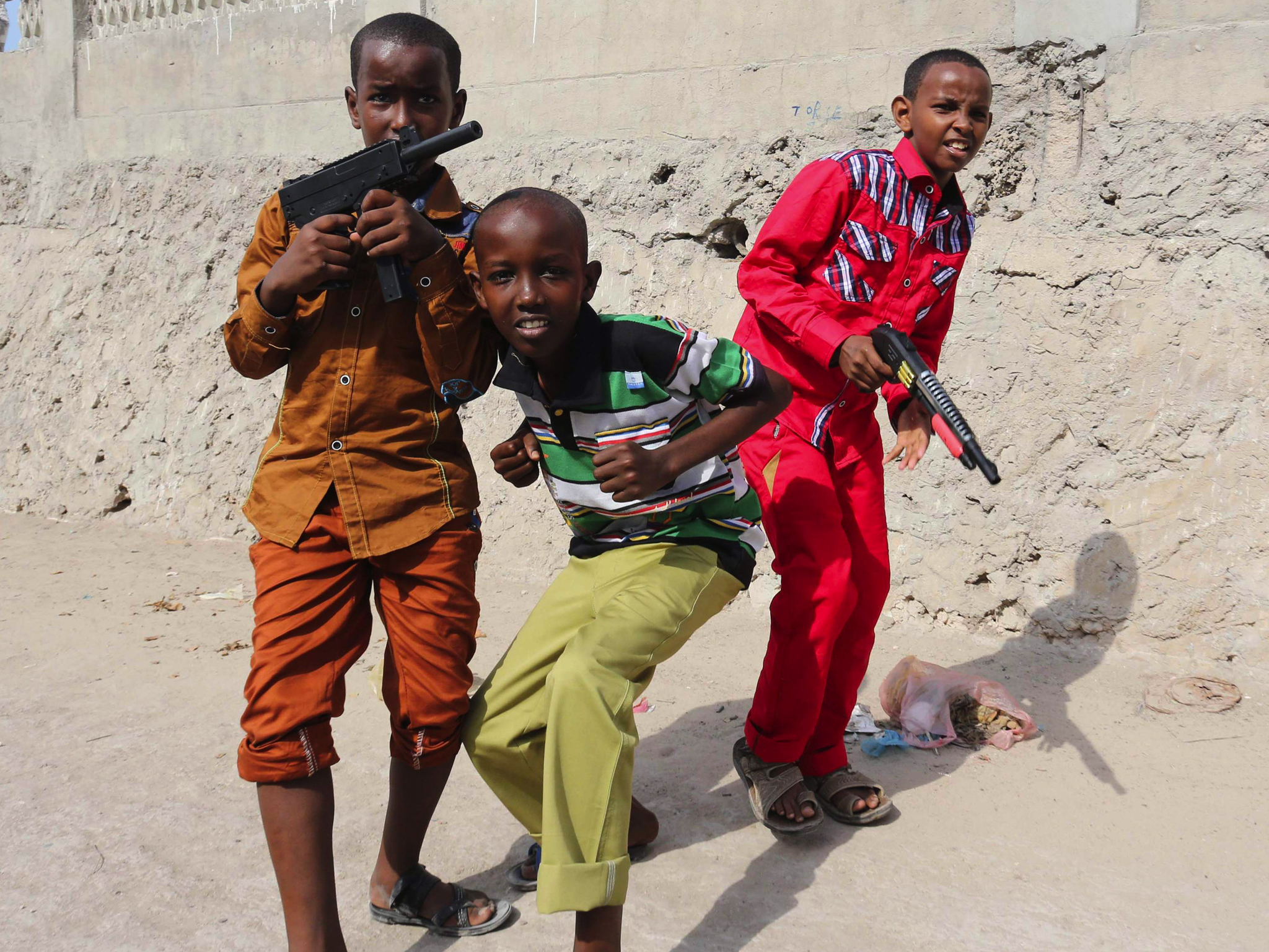 Boys play with their toy guns after attending Eid al-Fitr prayers to mark the end of the fasting month of Ramadan in Somalia's capital Mogadishu.