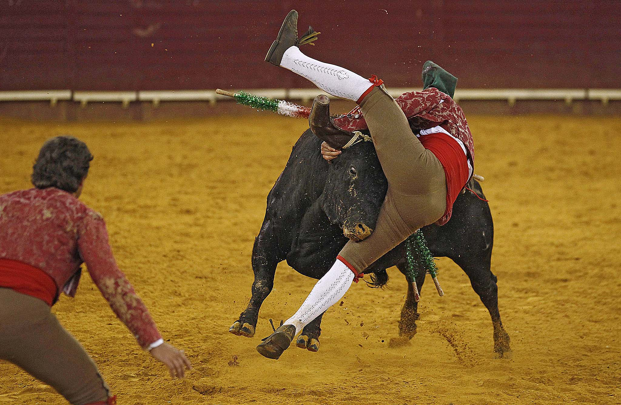 Members of Vila Franca forcados group perform during a bullfight at Campo Pequeno bullring in Lisbon