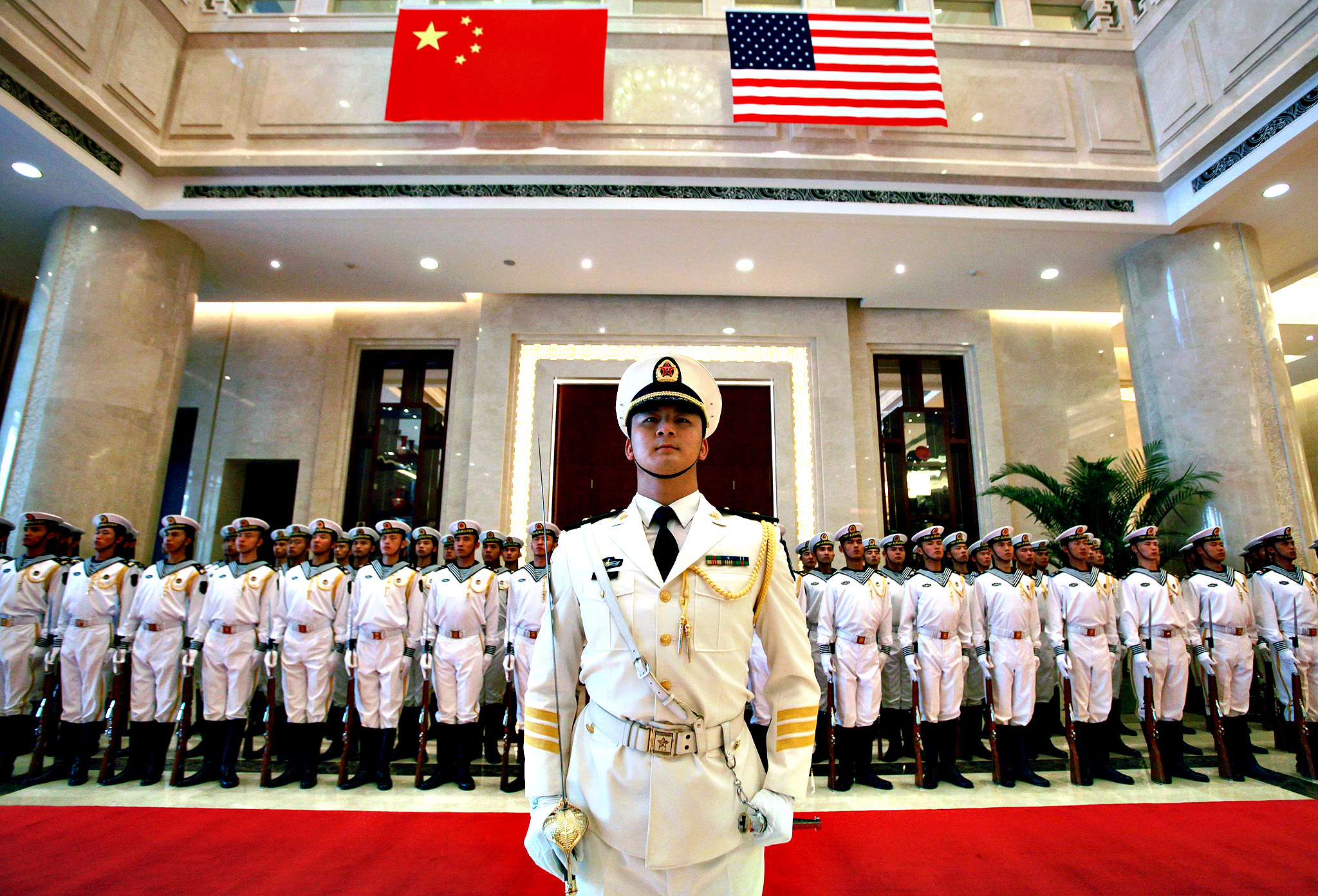 A military honor guard prepares for US Chief of Naval Operations Admiral Jonathan Greenert's visit with Commander in Chief of The People's Liberation Army (PLA) Navy Admiral Wu Shengli at a welcoming ceremony at the PLA Navy headquarters outside of Beijing, China, 15 July 2014.  For the first time since 1971 China's navy participated alongside the US navy in Rim of the Pacific naval exercises last week.