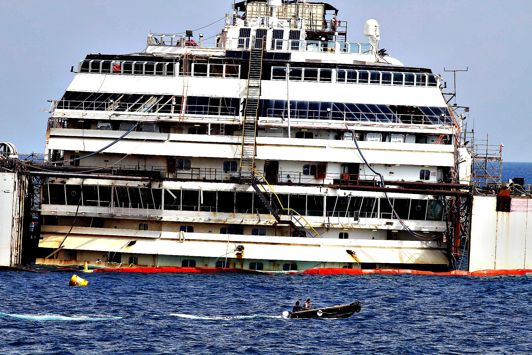 The wreck of the Costa Concordia cruise ship, which was hauled upright in September but stil partially submerged, is slowly being refloated near the port of Giglio Island, Italy, 14 July 2014 in one of the biggest maritime s The Concordia hit a reef and partly capsized on 13 January 2012, after being steered dangerously close to Giglio. Thirty-two of the 4,229 people onboard died in the accident.