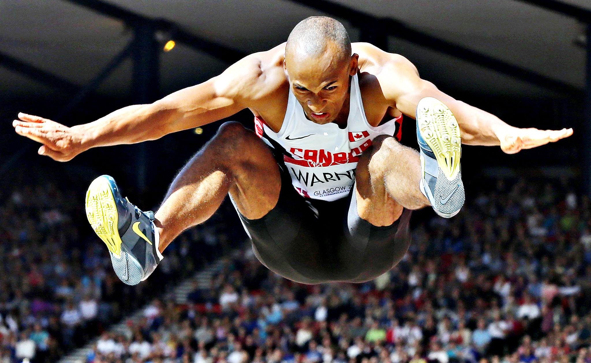 Canada's Damian Warner competes in the Men's Decathlon Long Jump at the 2014 Commonwealth Games in Glasgow, Scotland, July 28, 2014.