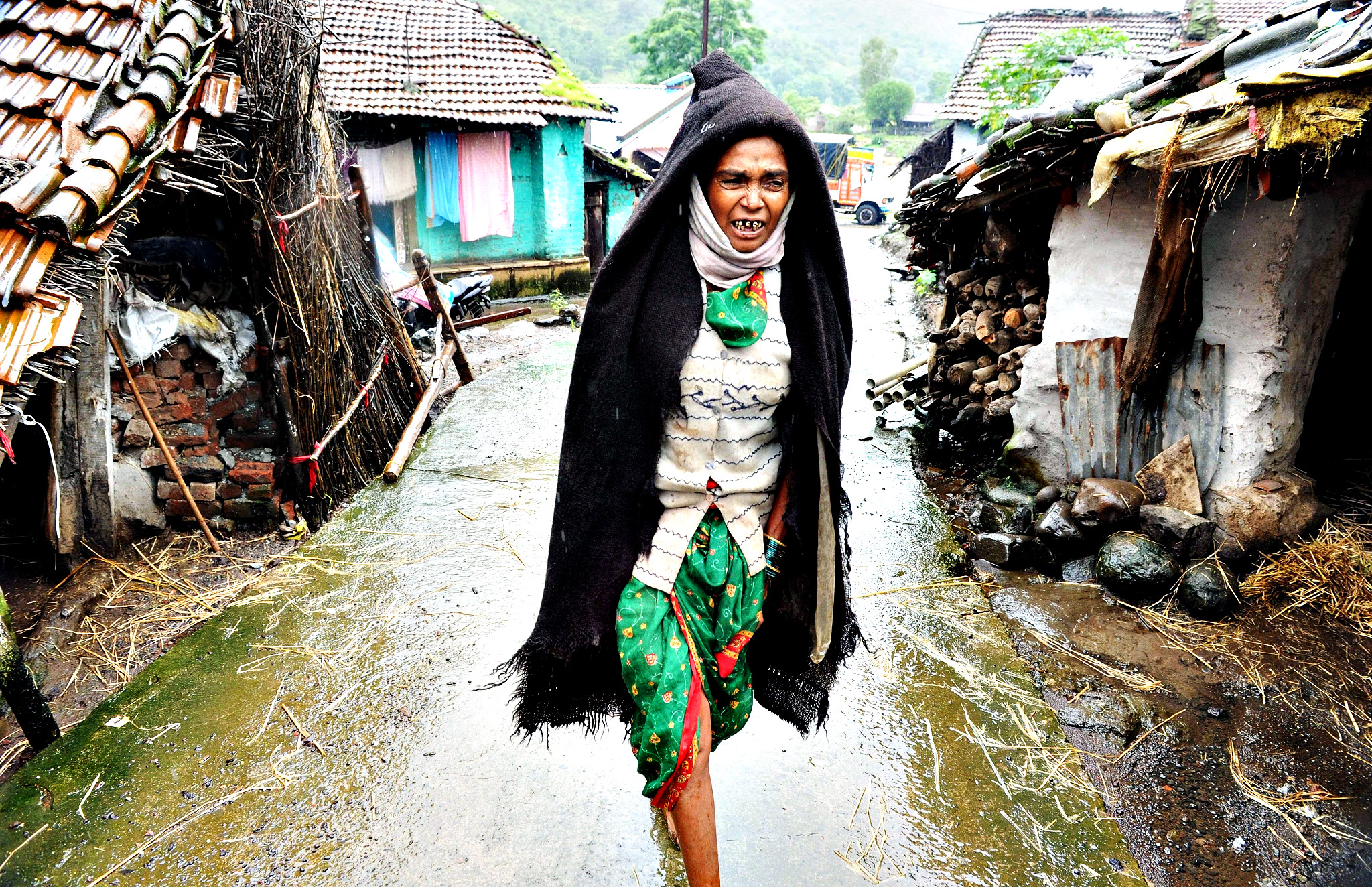 A Indian villager walks near the scene following a landslide at Malin village in Pune district of India's western Indian state of Maharashtra on July 31, 2014. Rescuers battled through heavy rains in a desperate search for victims of a landslide in western India that buried dozens of homes, with fears the death toll could reach 150.