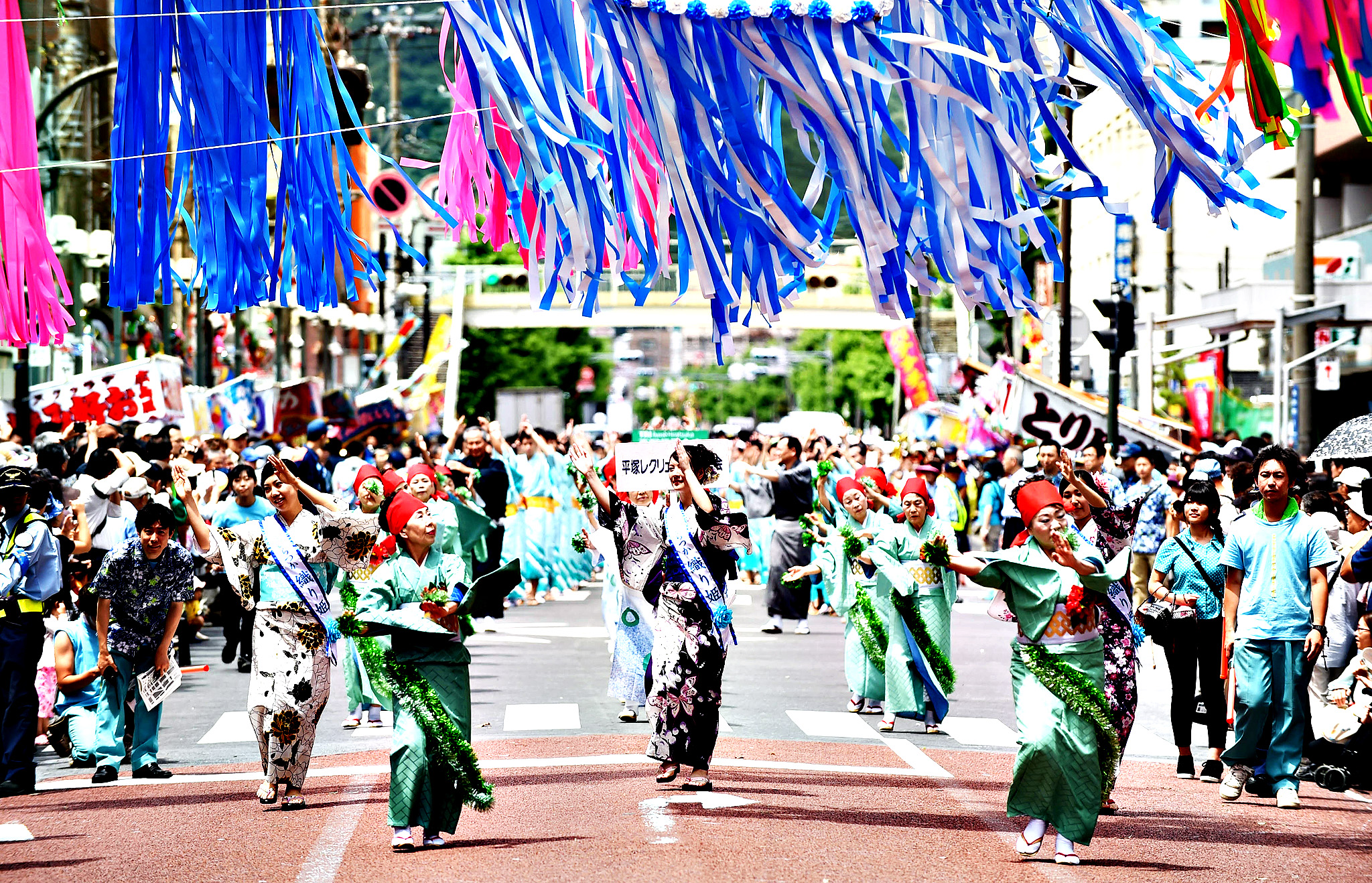 Dancers dressed in traditional costume perform dance under the colorful ornaments of Tanabata during the Shonan Hiratsuka Tanabata Festival on July 4, 2014 in Hiratsuka, Japan. Tanabata is a Japanese star festival celebrated on July 7 every year. People enjoy going out wearing traditional yukata robe and write their wishes on colorful paper strips to hang on bamboo trees.