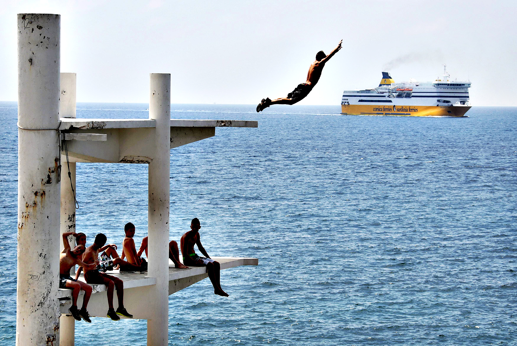 A man dives dive into the Mediterranean Sea during a sunny summer day in Nice, southeastern France, July 28, 2014.