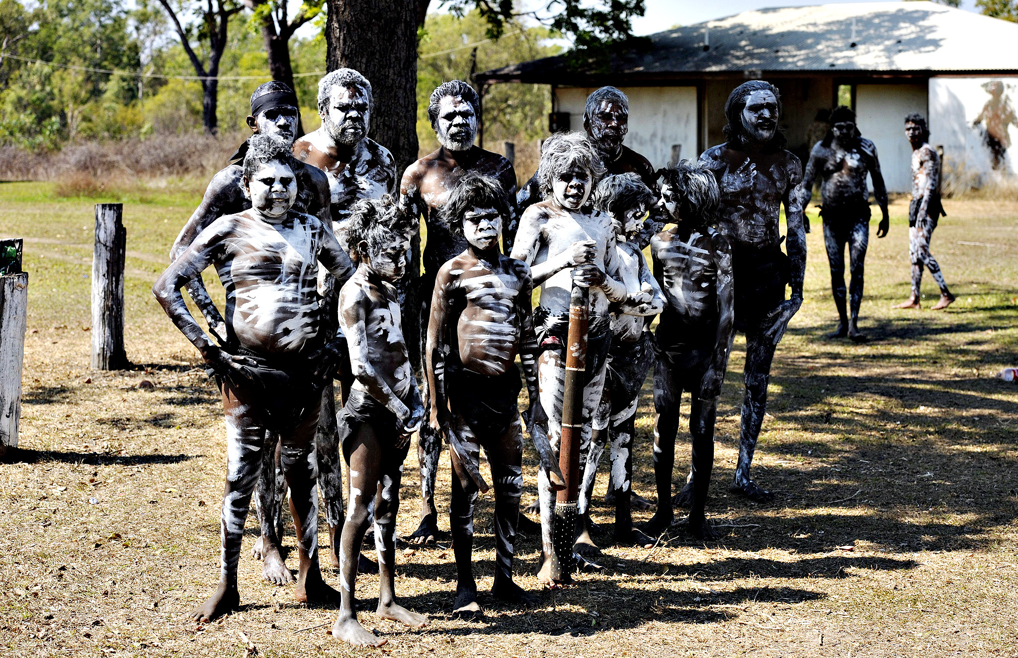 Traditional dancers wait to perform before the swearing-in of members of the new West Daly Regional council in the aboriginal community of Peppimenarti, about 320km south-west of Darwin, Australia, 04 July 2014. The Northern Territory (NT) government is dismantling the Supershire network set up by the previous Labor government in favour of 63 local council to better represent local communities.