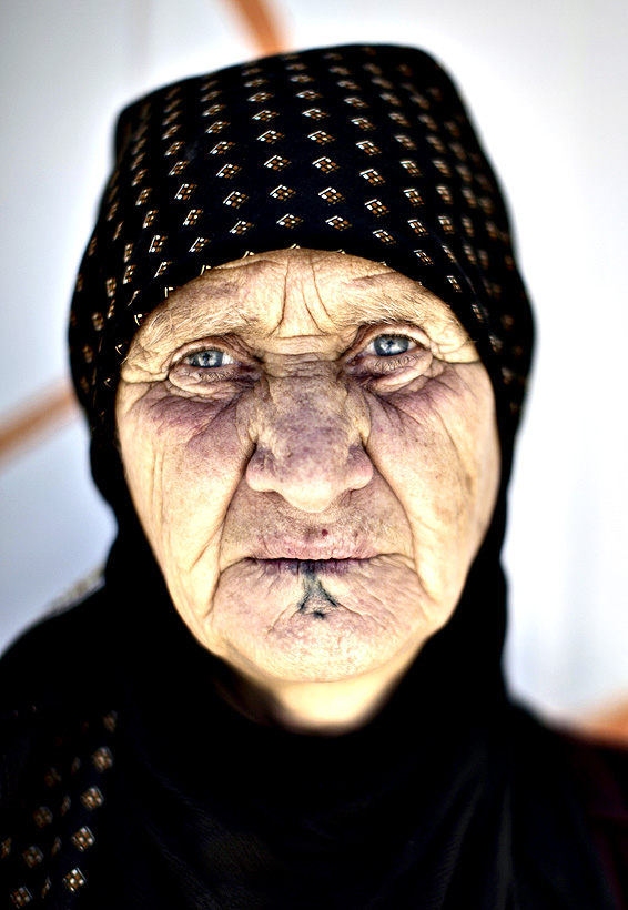 Elderly Syrian refugee Saltiya Ibraheem, 70, poses for a picture outside her makeshift home in Zaatari refugee camp, near the Syrian border, in Mafraq, Jordan on Wednesday
