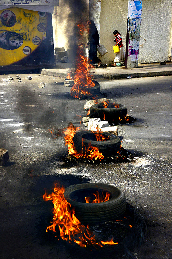 Yemeni's pass burning tyres on a road during a protest against fuel price hikes in Sana'a, Yemen, 30 July 2014. According to media reports, the Yemeni government raised fuel prices on 30 July to reduce the burden on state subsidies following severe fuel shortage for more than five months.
