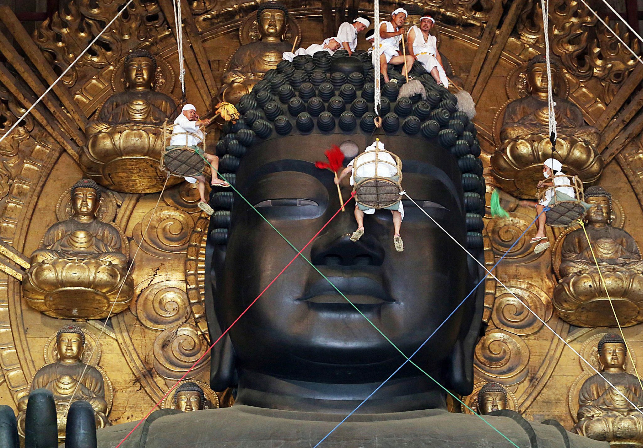Buddhist monks and volunteers c...TOPSHOTS Buddhist monks and volunteers clean the 15-metre-tall great Buddha statue during the annual Ominugui ceremony at Todaiji Temple in Japan's ancient capital Nara, western Japan on August 7, 2014. People visited the temple as they believe that a person who collects the dust during the ceremony will be trouble-free for a year. AFP PHOTO / JIJI PRESS    JAPAN OUTJIJI PRESS/AFP/Getty Images